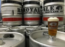 A frothy Royale Brewing Fat Unicorn Pale Ale amongst the kegs at its production brewery.