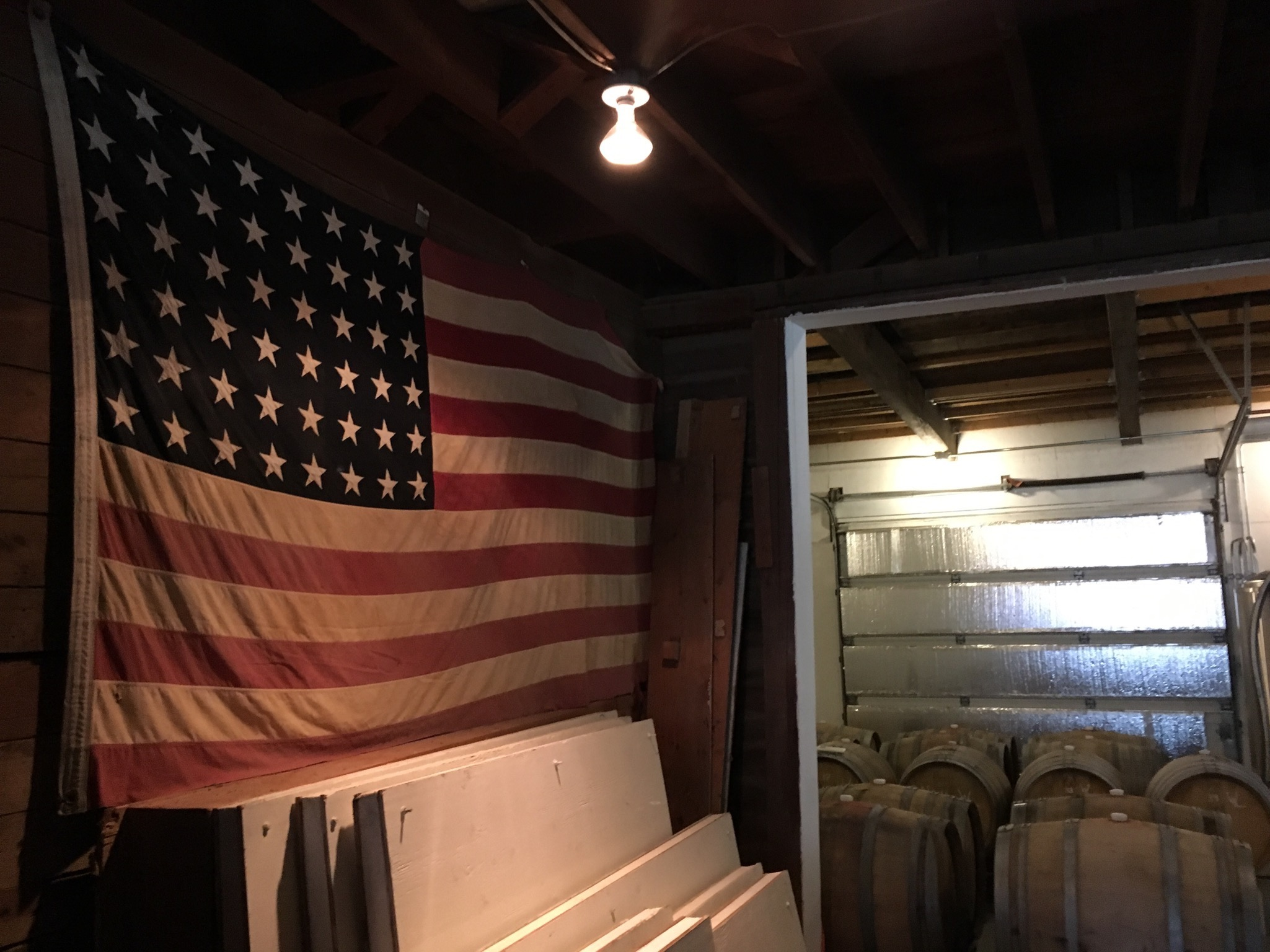48 Star United States Flag inside Wolves & People Farmhouse Brewery. (photo by Cat Stelzer)