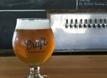 A glass of Three Creeks Crowdpleaser IPA at Craft Pour House.