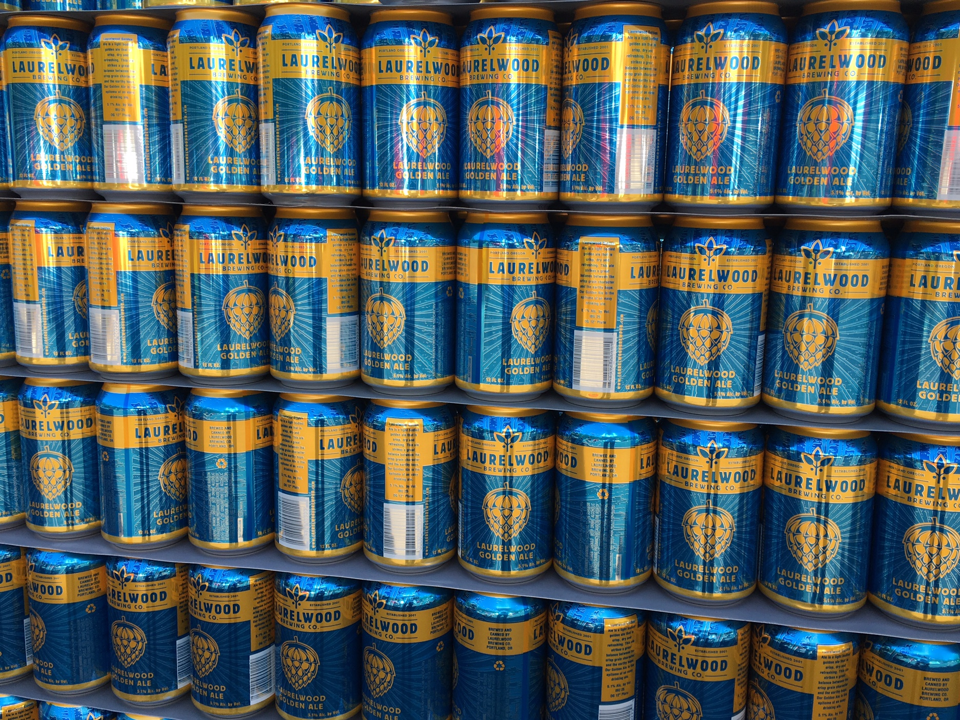 A pallet of empty cans of Laurelwood Golden Ale.