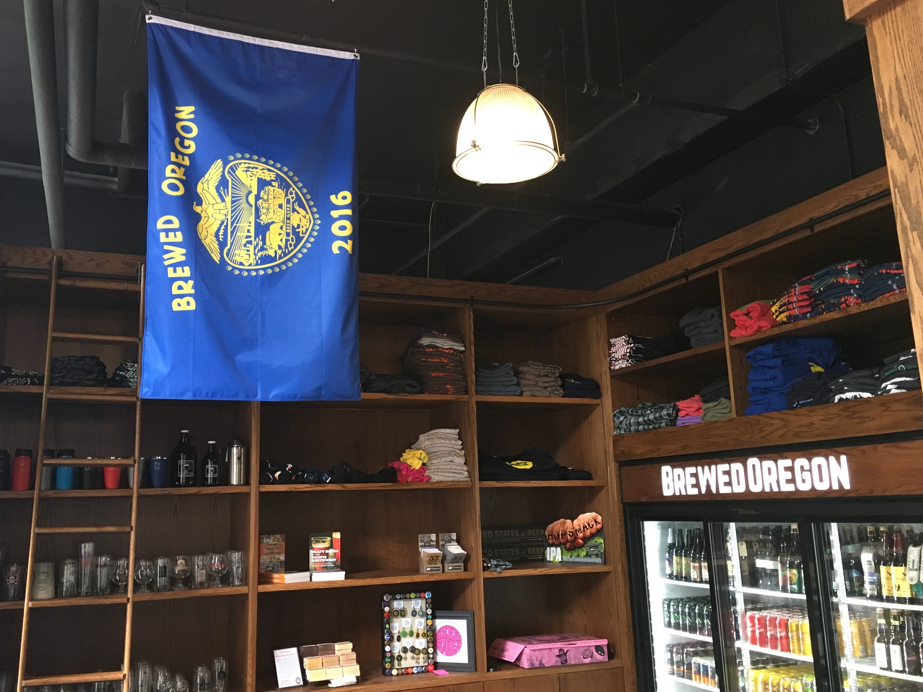 BrewedOregon flag proudly hanging over the Oregon brewery merchandise