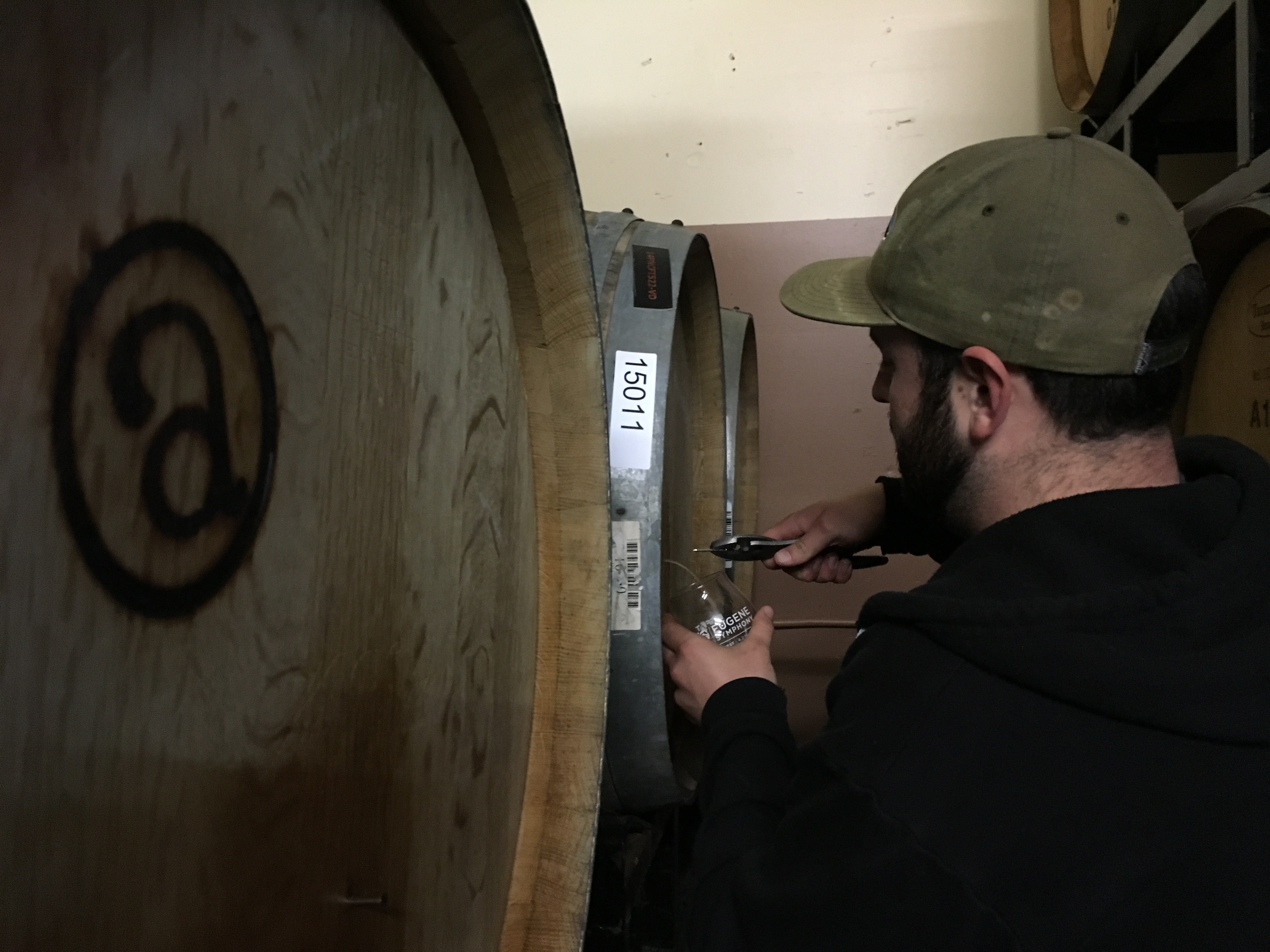 Brian Coombs pulling nails at Alesong Brewing & Blending.