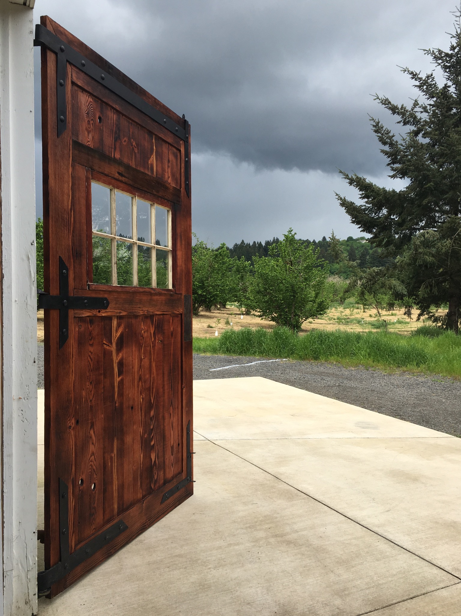 Looking out into the farmland through the beautiful wooden brewery doors at Wolves & People. (photo by Cat Stelzer)