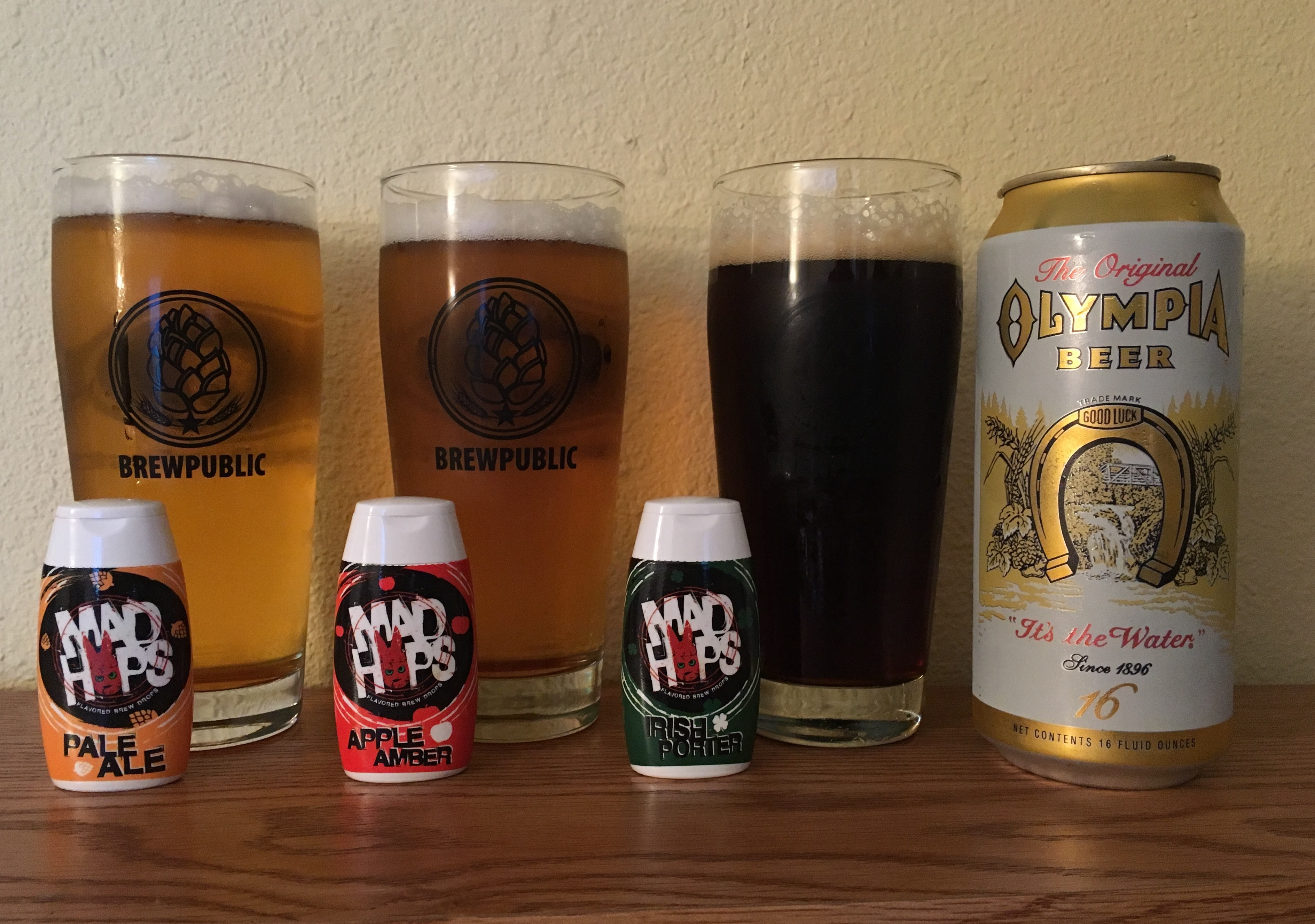 Mad Hops Pale Ale, Apple Amber, and Irish Porter mixed with Olympia Beer.