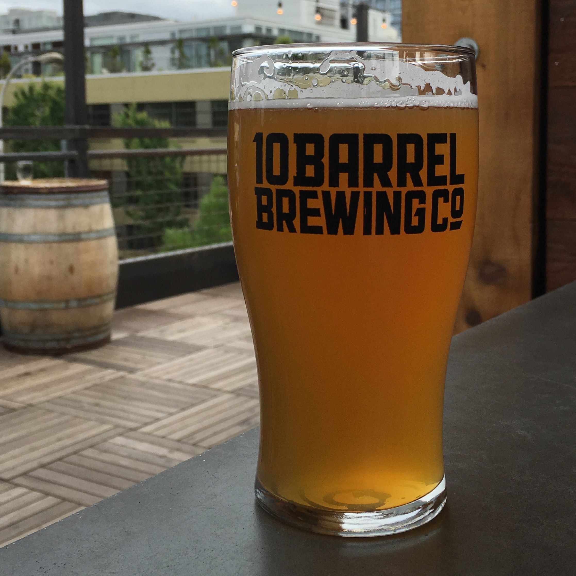A pint of 10 Barrel Brewing Pina Pineapple Passion Fruit Summer Ale at the new rooftop bar at its pub in Portland.