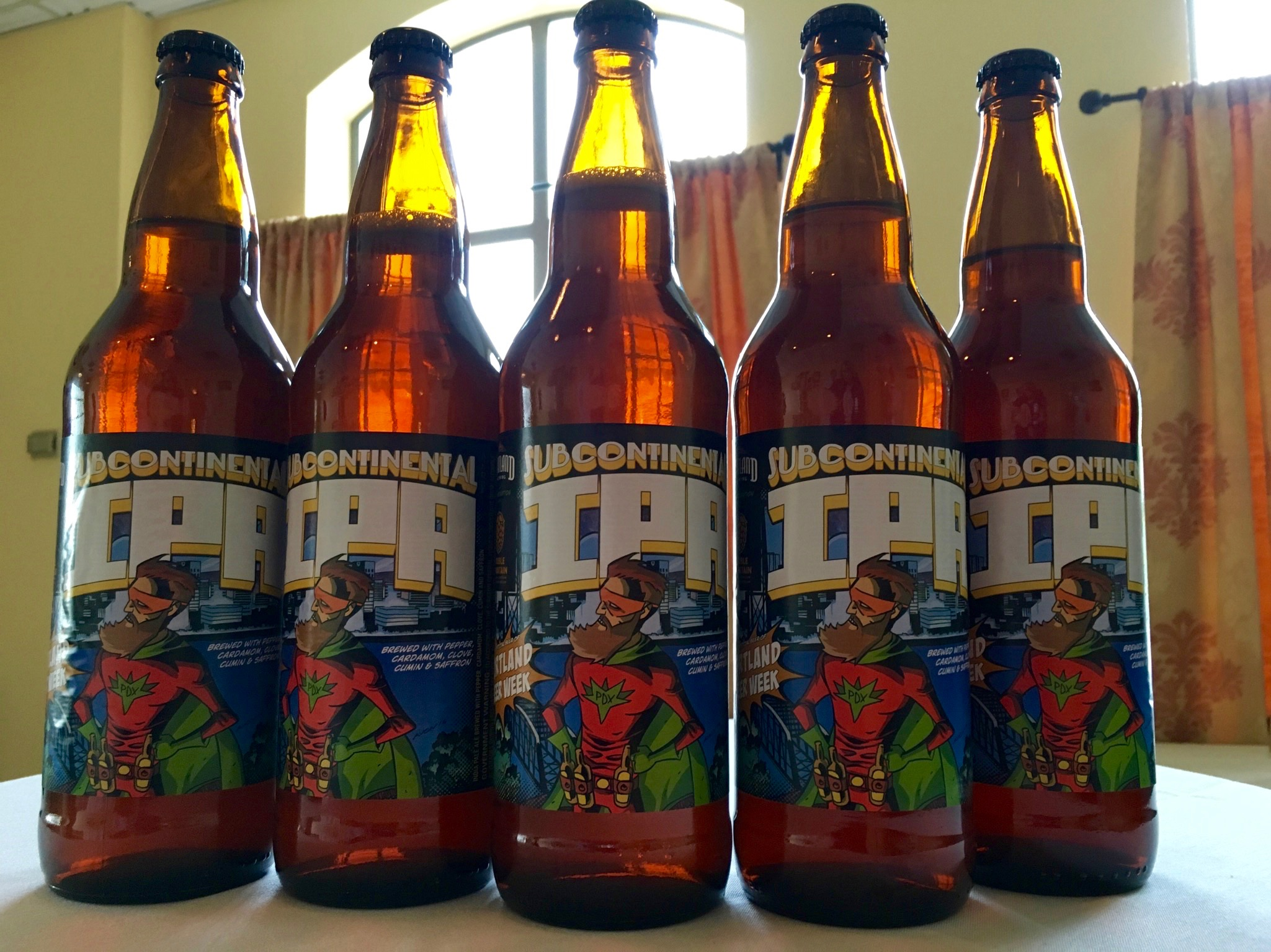 Bottles of Portland Brewing and Double Mountain Subcontinental IPA. (photo by Cat Stelzer)