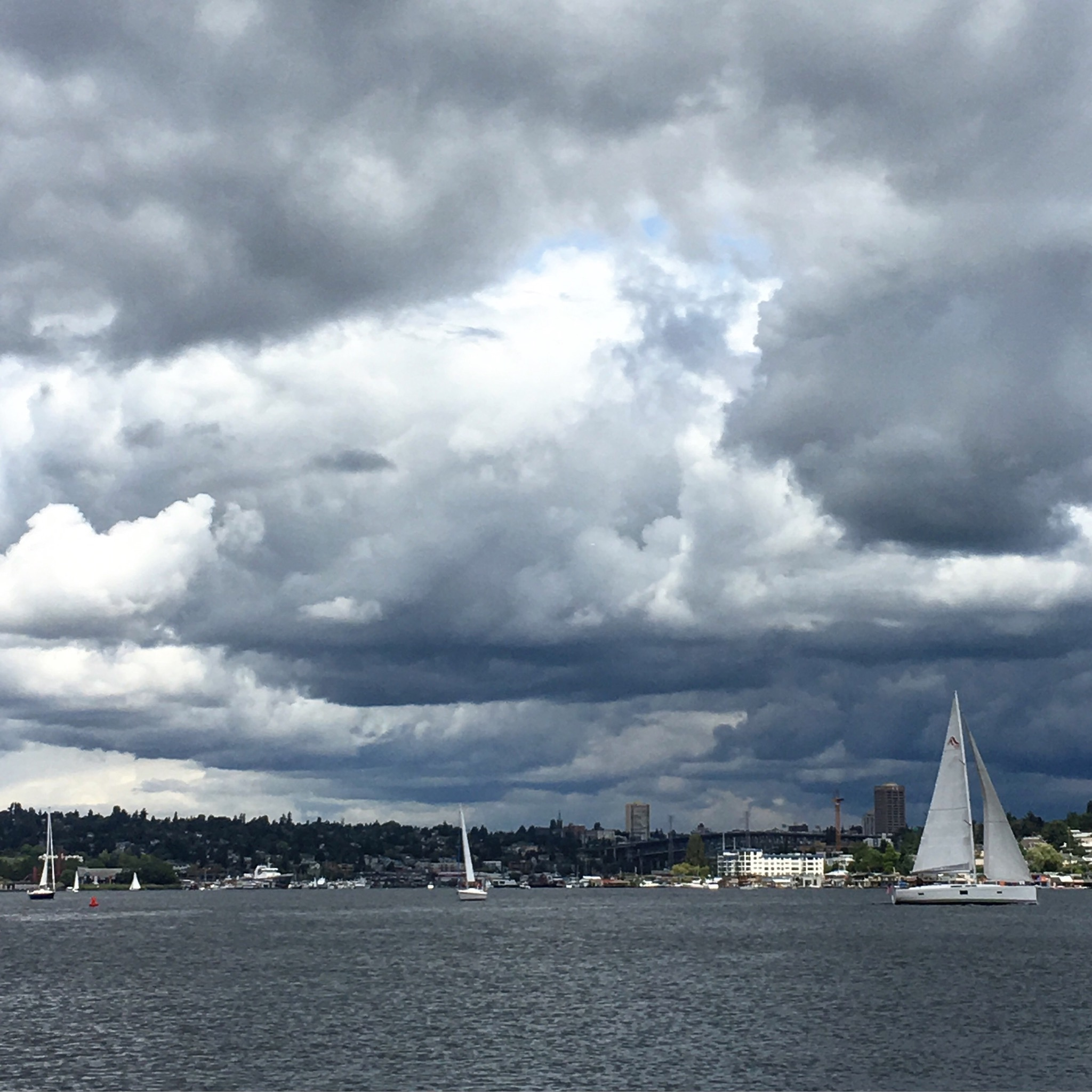 Clouds overtaking the sky above Lake Union. (photo by Cat Stelzer)