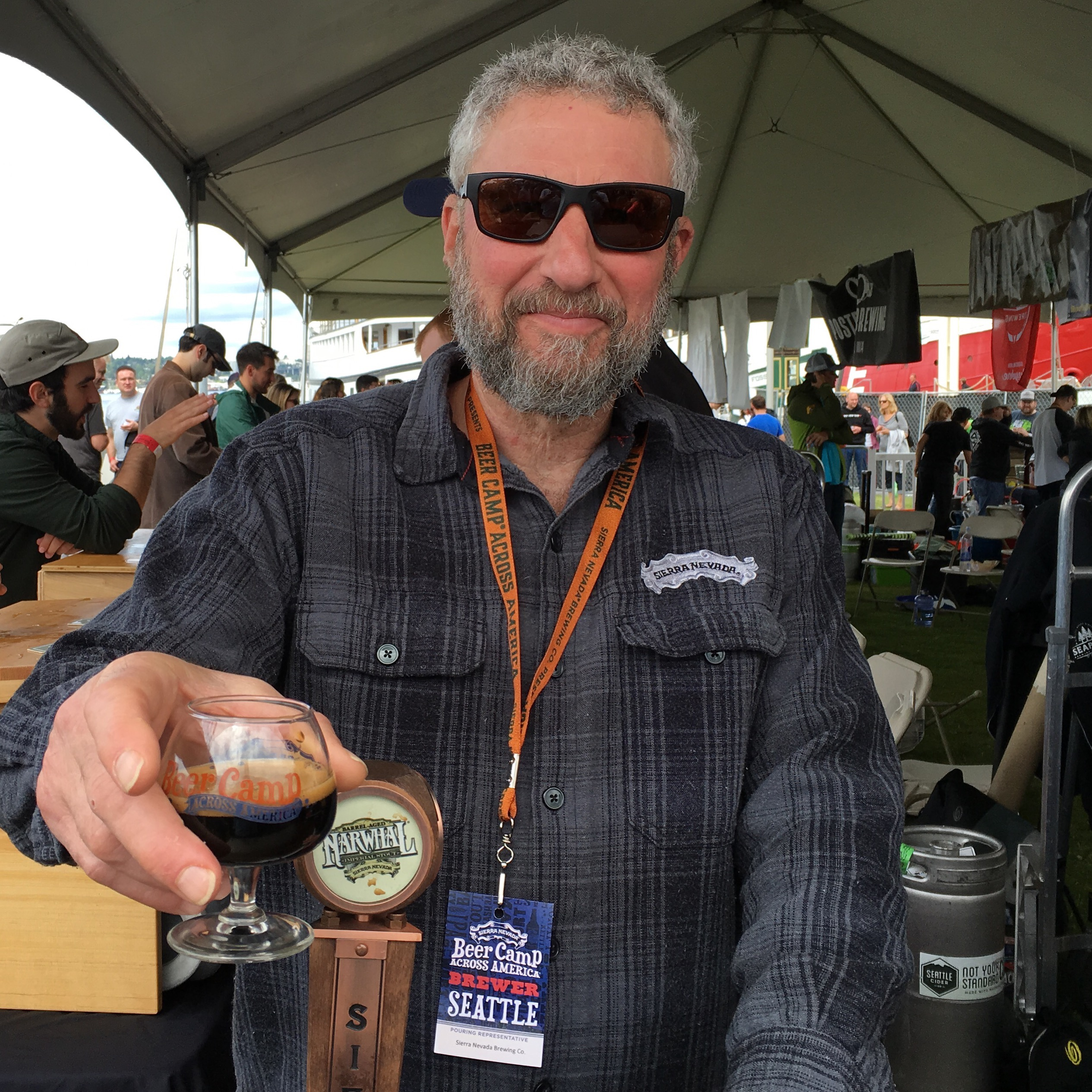 Ken Grossman pours a Sierra Nevada Barrel Aged Narwhal at Sierra Nevada Beer Camp Across America Festival. (photo by D.J. Paul)