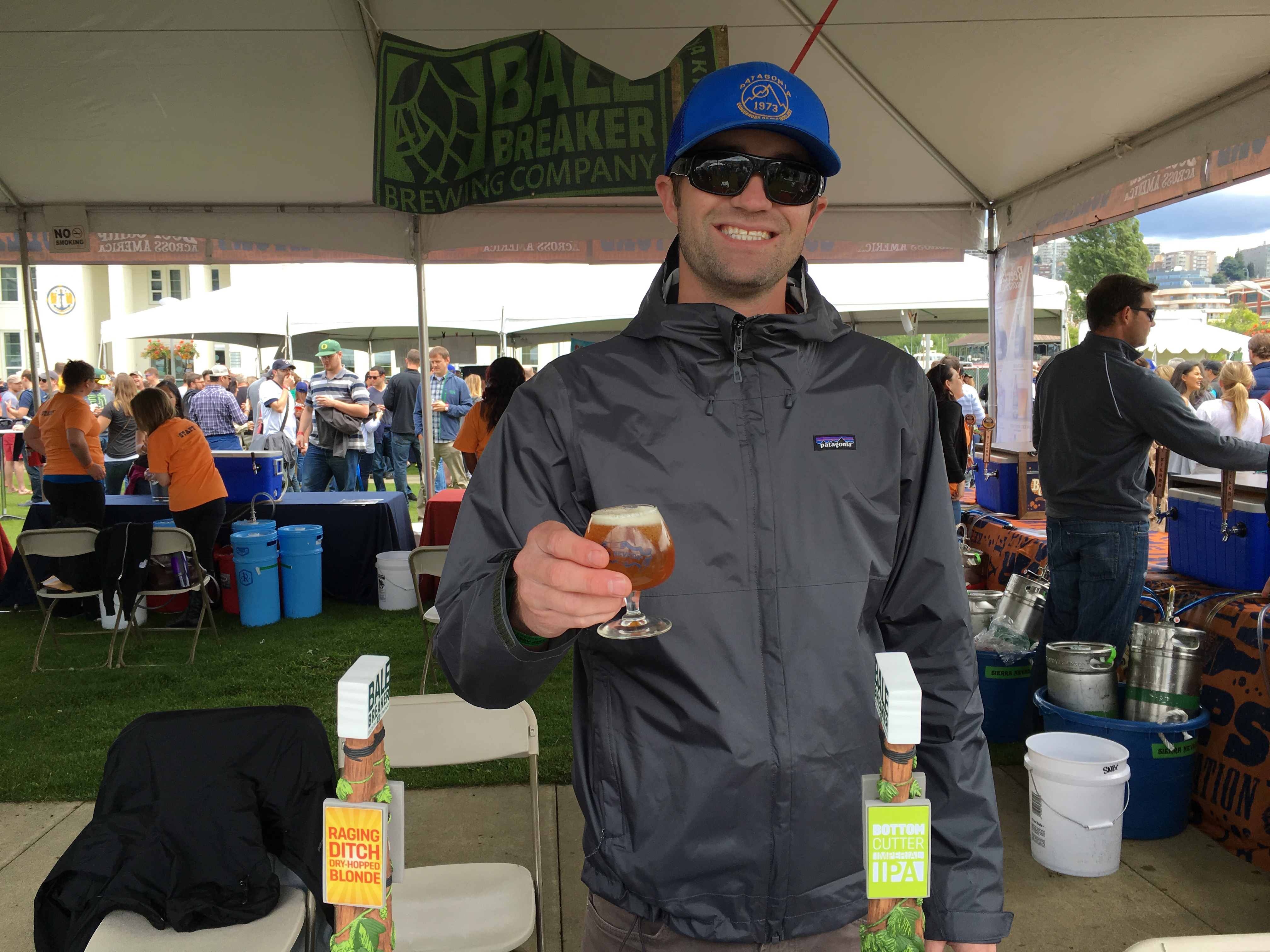 Kevin from Bale Breaker Brewing serving a Raging Ditch Dry-Hopped Blonde at Sierra Nevada Beer Camp Across America Festival in Seattle. (photo by D.J. Paul)