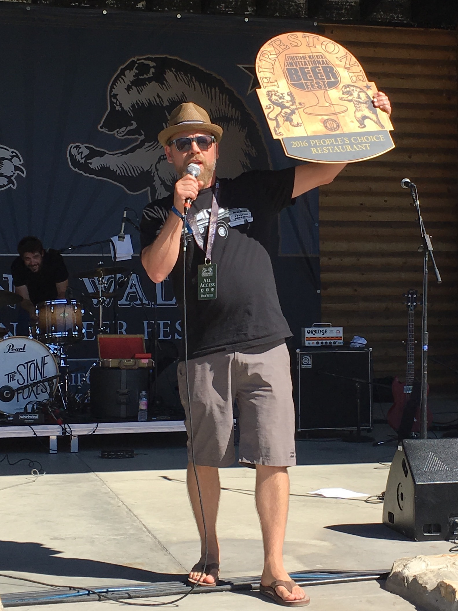 Matt Brynildson holds up the award for the 2016 People's Choice Restaurant during the 2016 Firestone Walker Invitational Beer Fest
