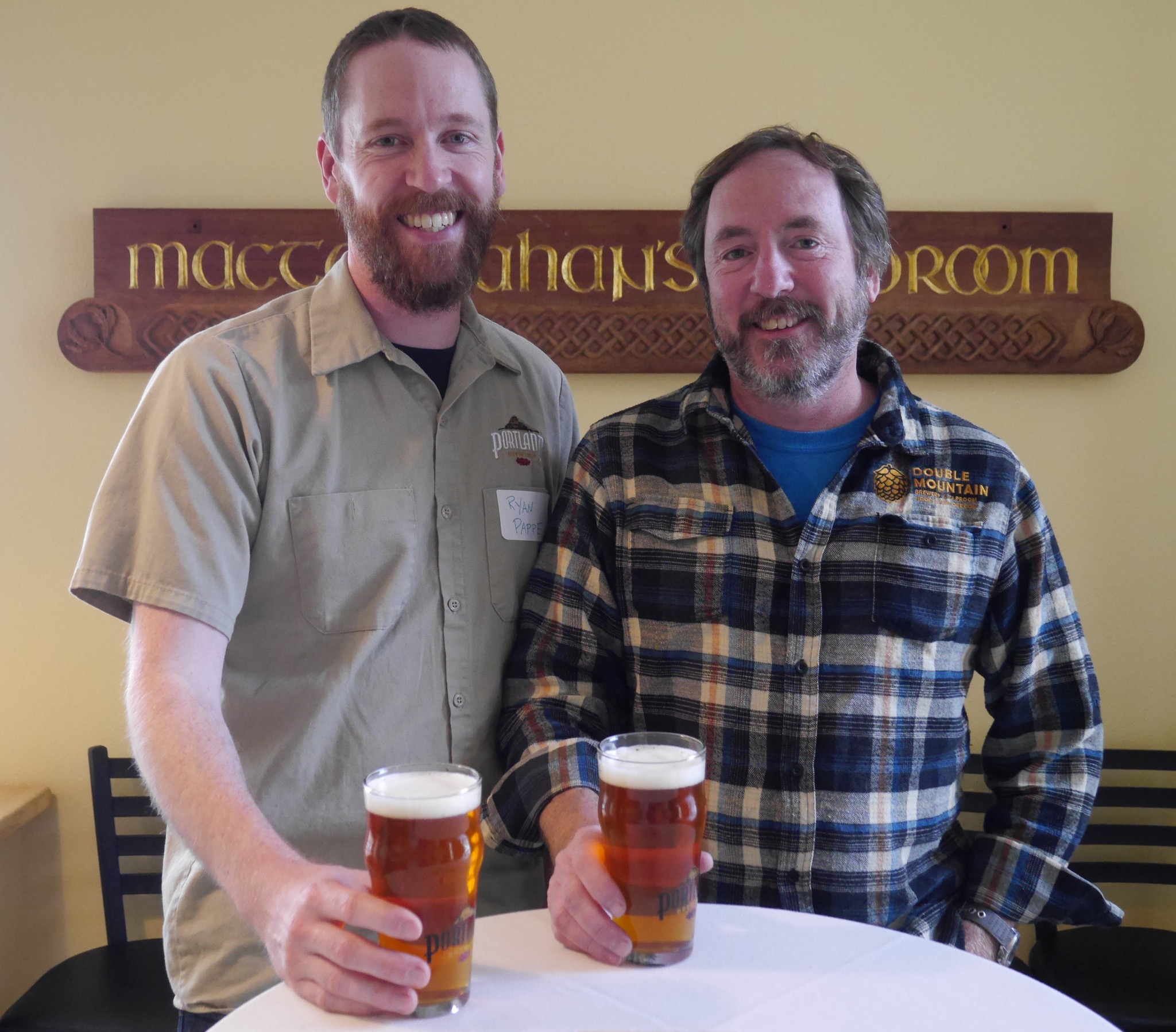 Portland Brewing's Ryan Pappe and Double Mountain's Matt Swihart enjoying a Subcontinental IPA during the PDX Beer Week media preview. (photo by Cat Stelzer)