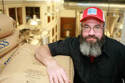 Public Coast Brewing Co. brewer Will Leroux. (image courtesy of Public Coast Brewing Co.)