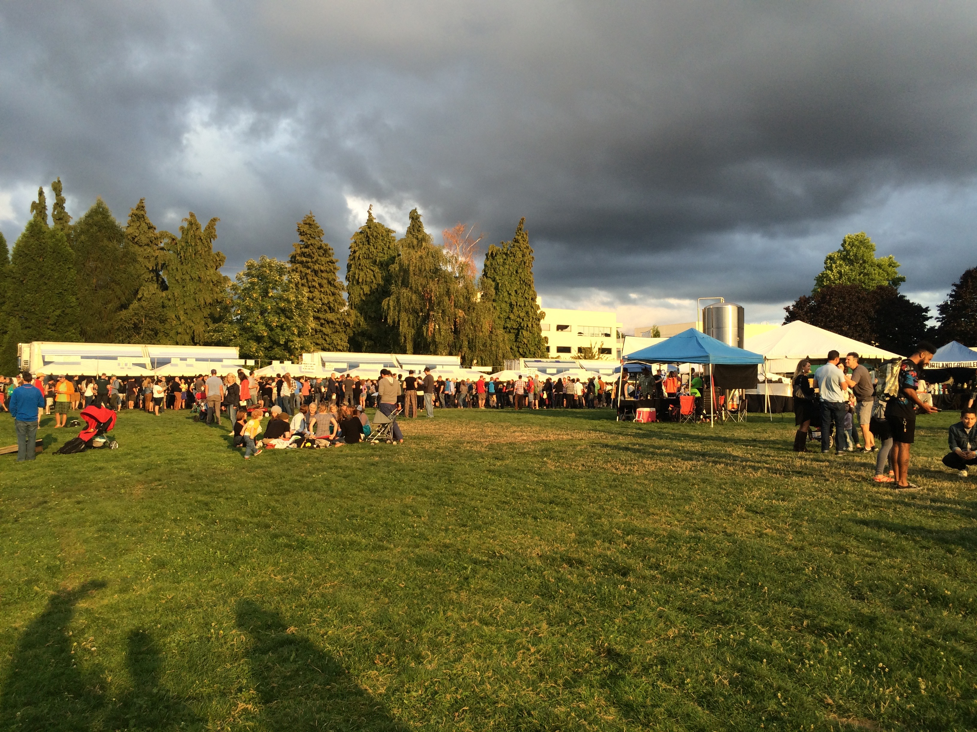 The sun peeks through some ominous clouds during the 2015 Organic Beer Fest in Portland, Oregon.