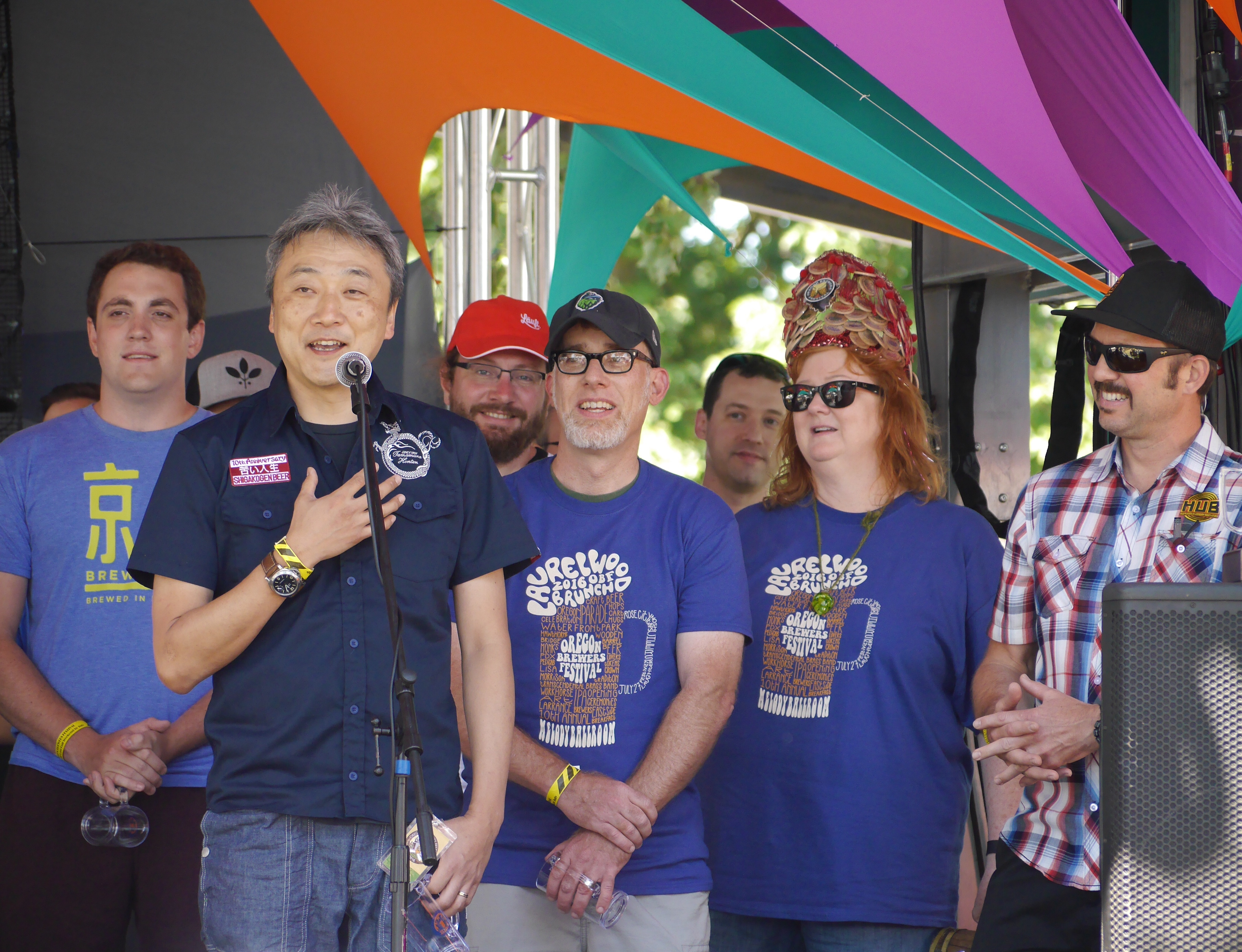 A few of the international brewers at the 2016 Oregon Brewers Festival Opening Ceremony as Lisa Morrison and Christian Ettinger look on from the far right. (photo by Cat Stelzer)