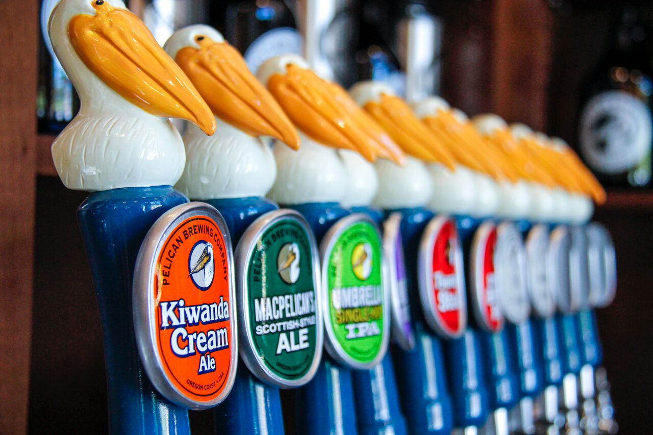 A lineup of Pelican Brewing taphandles. (image courtesy of Pelican Brewing)