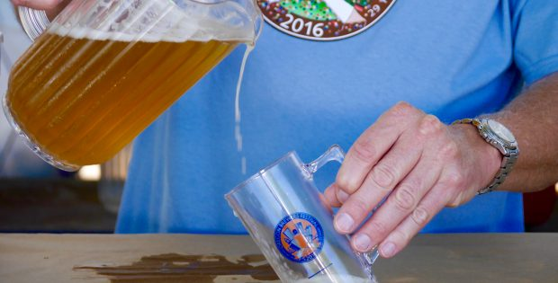 A pour of beer into the 2016 Oregon Brewers Festival mug. (photo by Cat Stelzer)