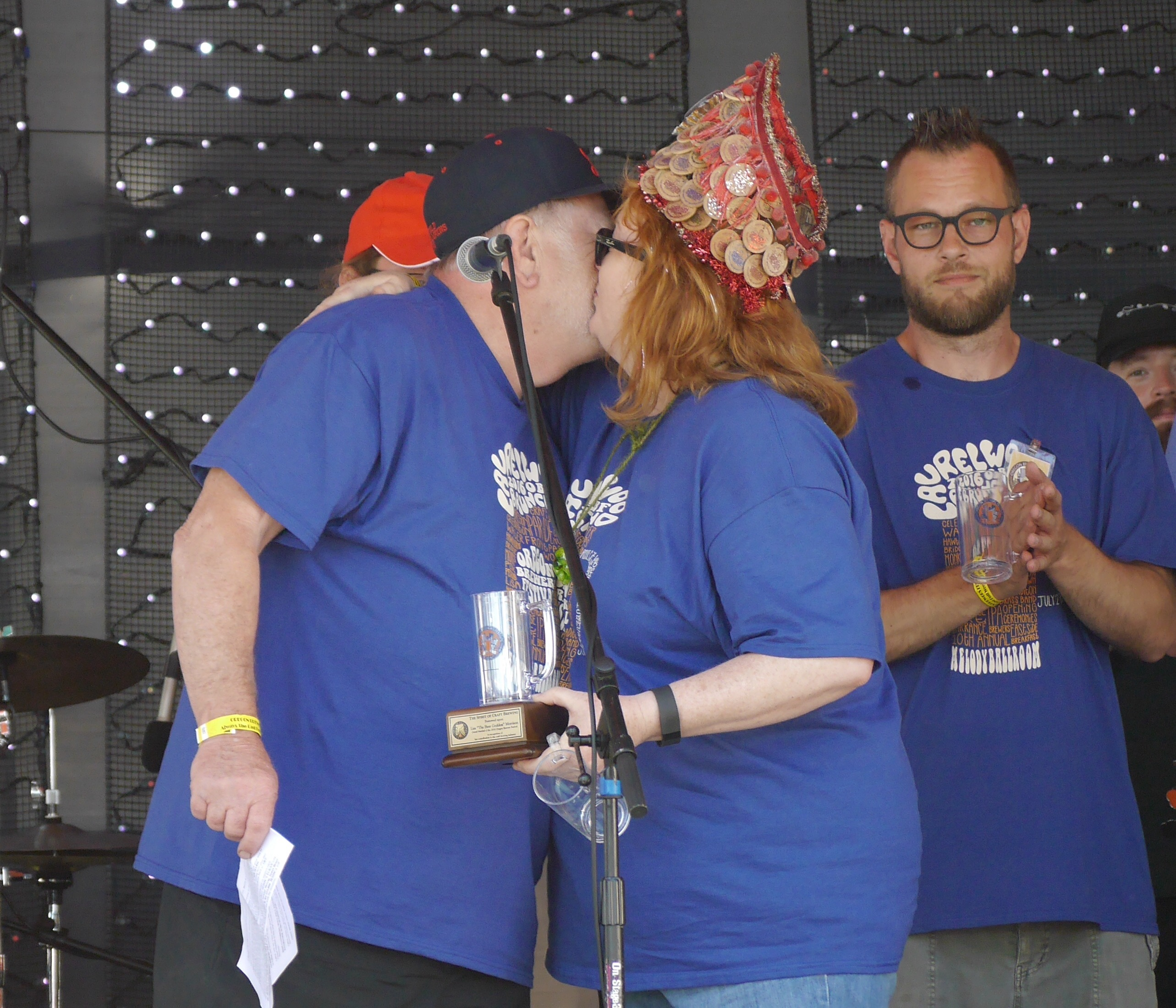 Art Larrance an Lisa Morrison embrace on stage during the 2016 Oregon Brewers Festival Opening Ceremony. (photo by Cat Stelzer)