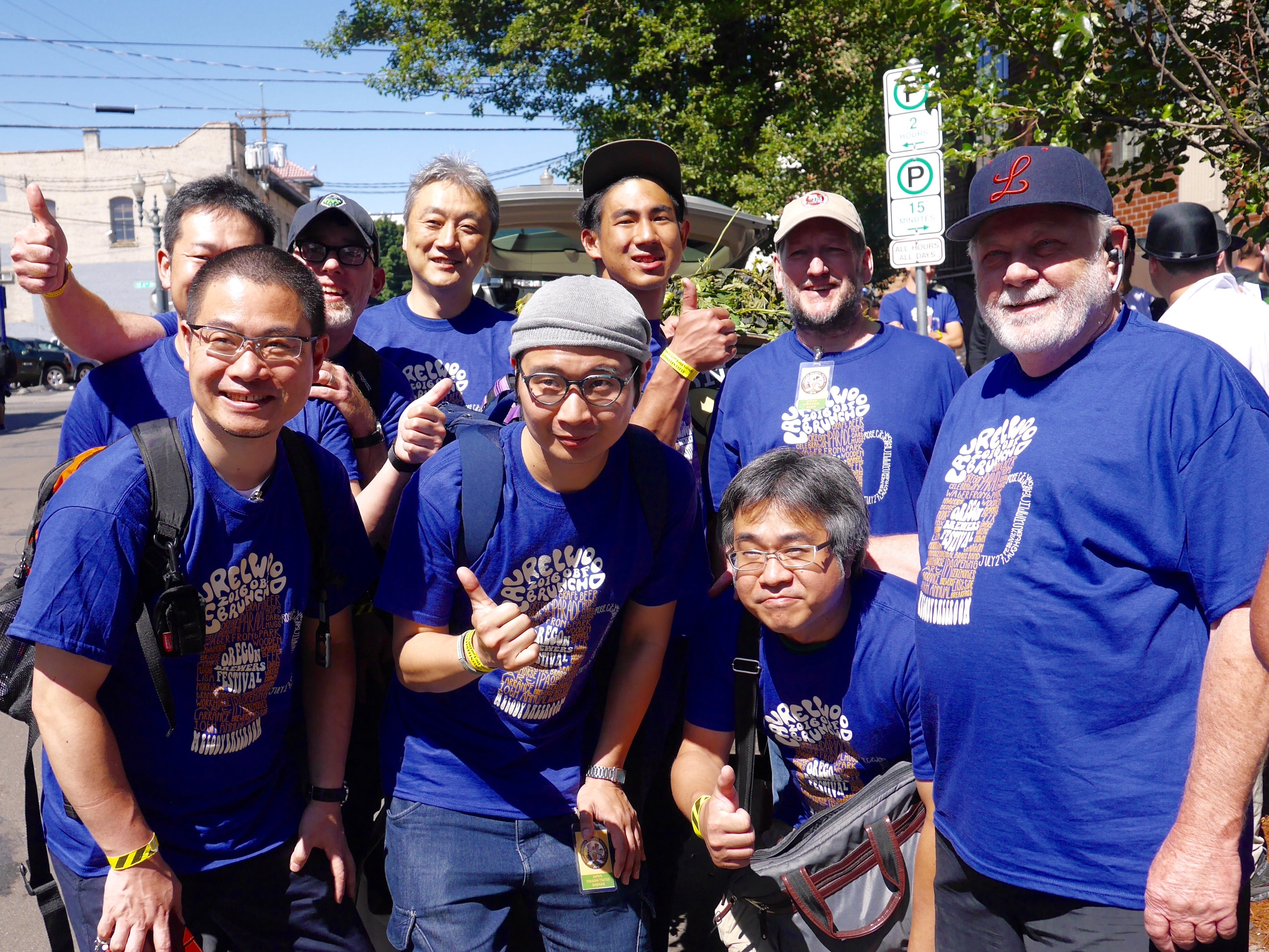 Art Larrance (far right) gathers with many of the international brewers from Asia. (photo by Cat Stelzer)