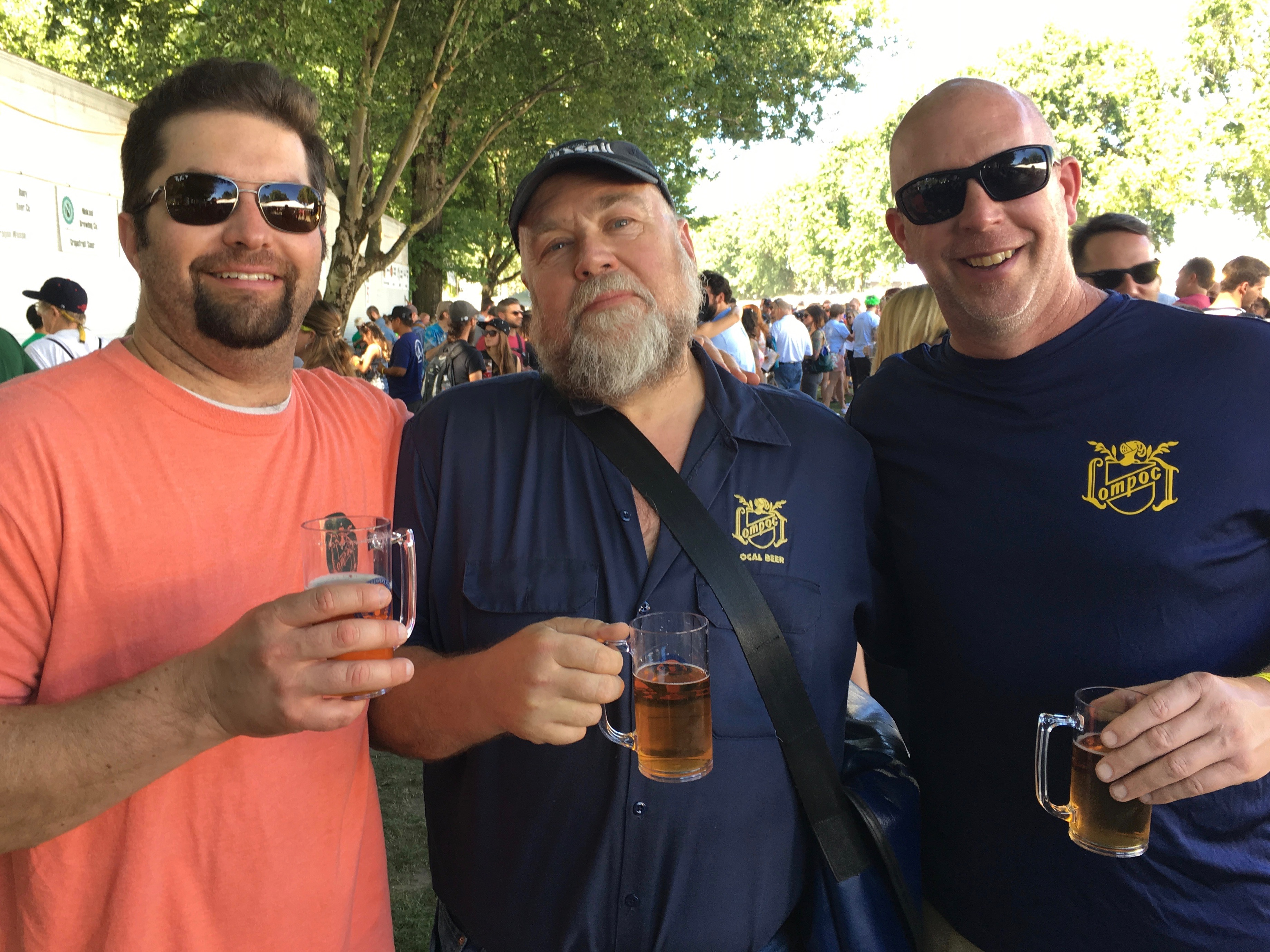 Bryan Keilty (left) and Jerry Fechter (right from Lompoc Brewing surround legendary beer writer John Foyston at the 2016 Oregon Brewers Festival.