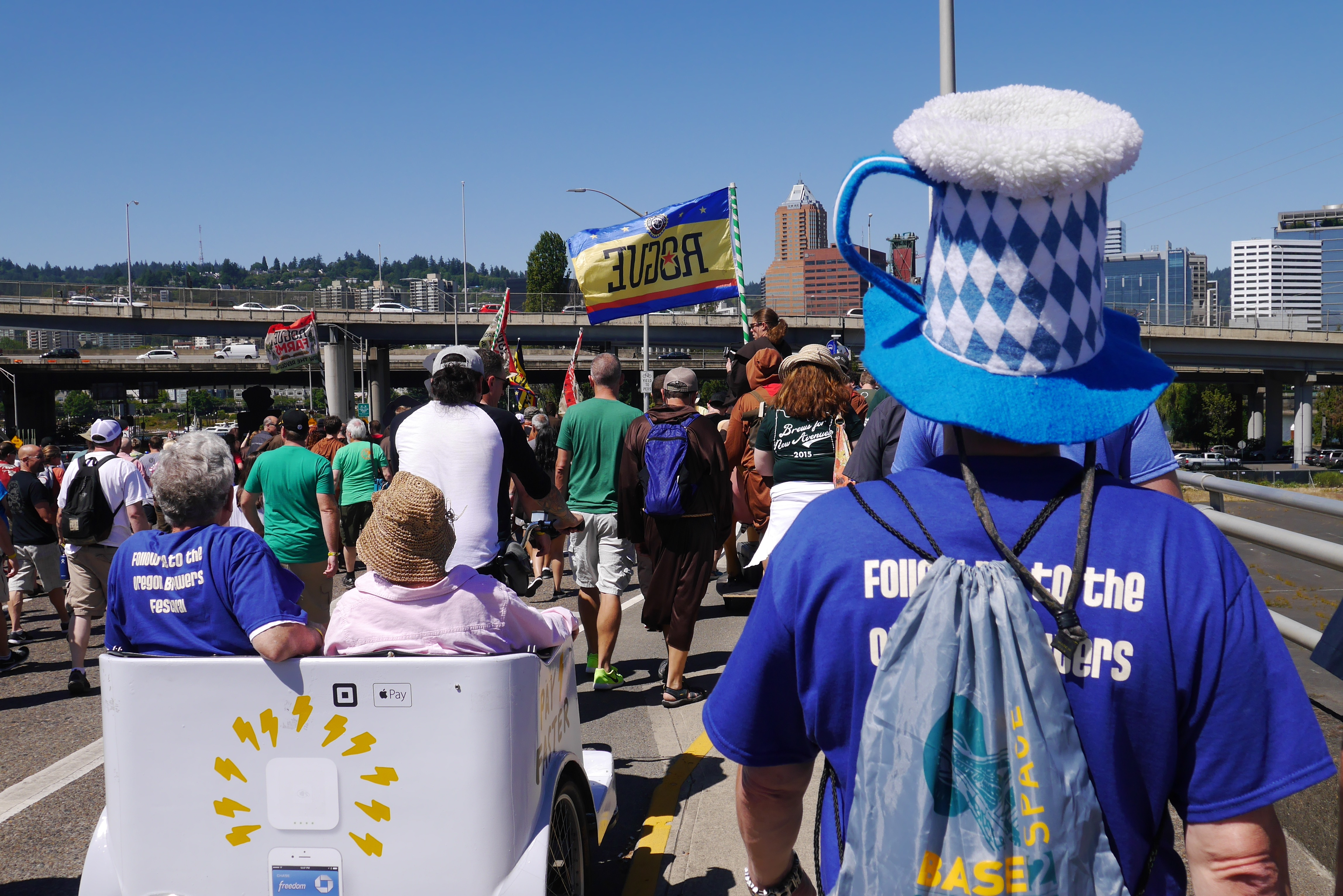 The Oregon Brewers Festival Parade marches on over the Hawthorne Bridge. (photo by Cat Stelzer)