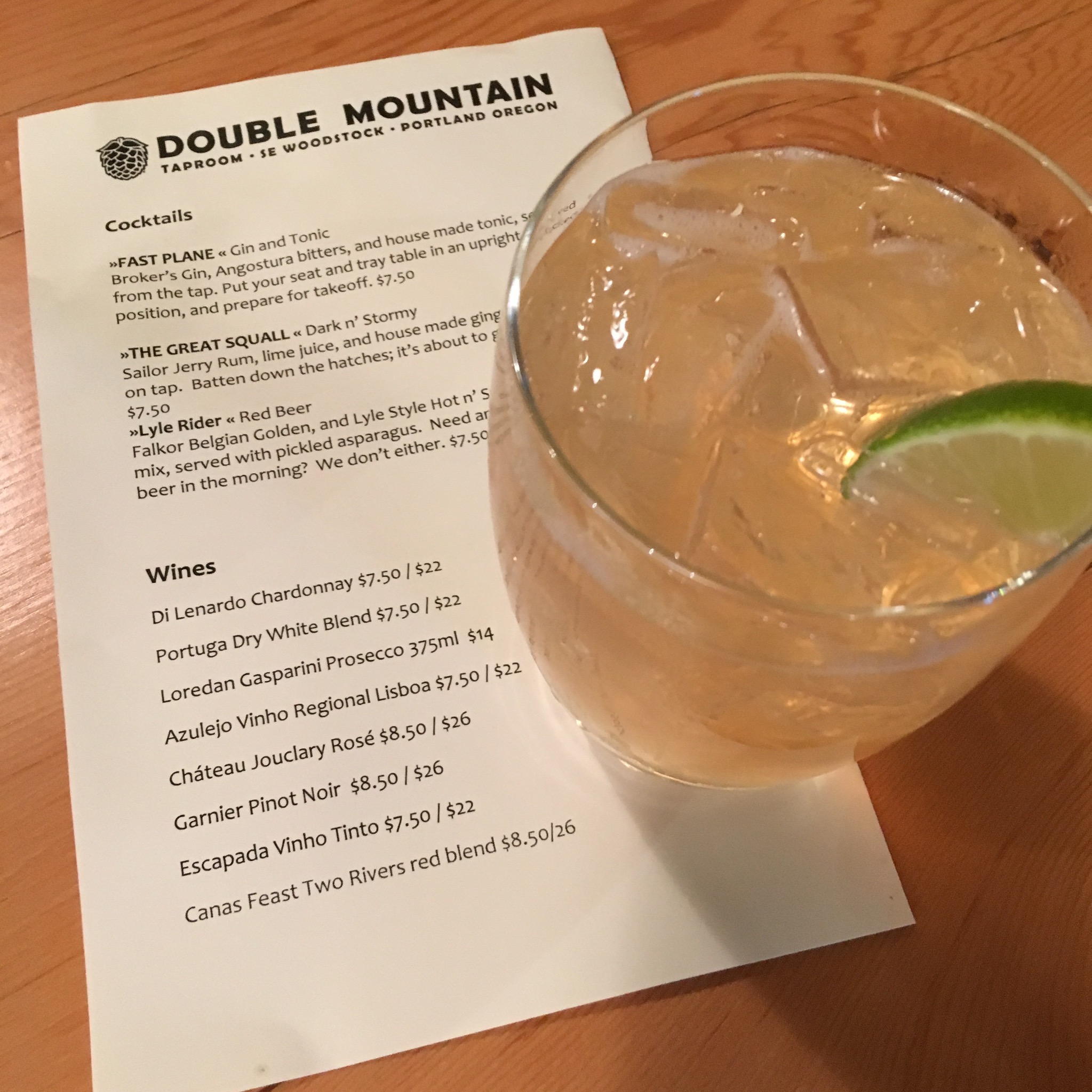 A Fast Plane Gin and Tonic alongside the Double Mountain Taproom Cocktail and Wine menu. (photo by Cat Stelzer)