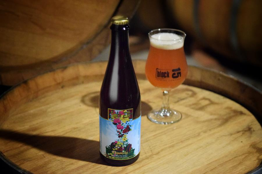 A bottle of Cassidy Farmhouse Ale w: Flowers, Aged in Sauternes Barrels. (image courtesy of Block 15 Brewery)