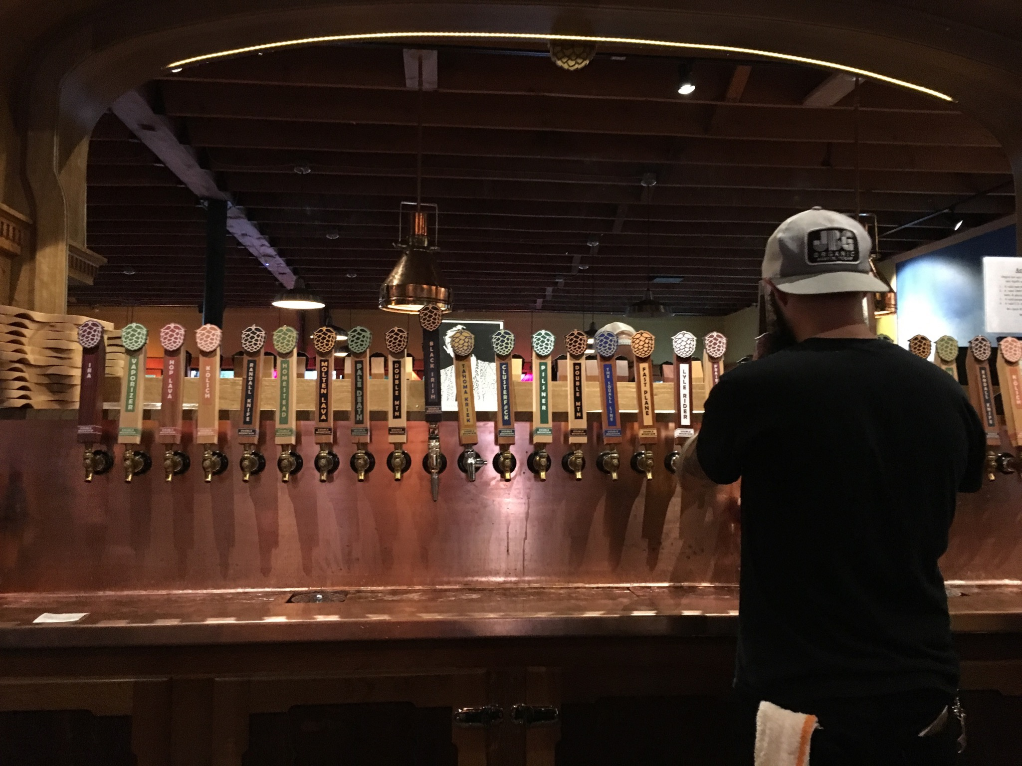 A lineup of 30 tap handles at Double Mountain Taproom in Portland, Oregon. (photo by Cat Stelzer)