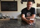 Abram Goldman-Armstrong, founder and owner of Cider Riot! behind the bar at the newly opened Cider Riot! Pub.