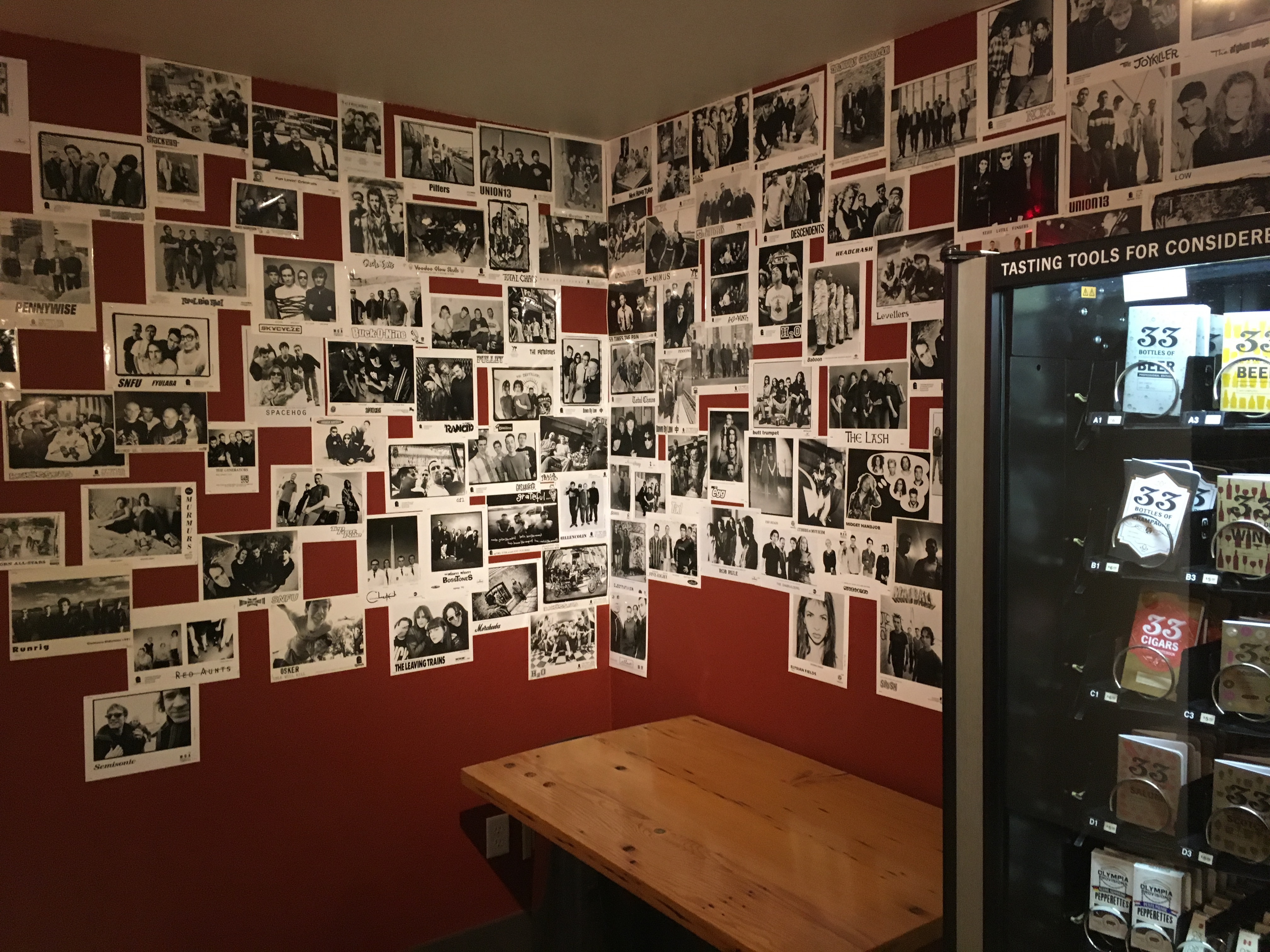 Many band press photos from Abram Goldman-Armstrong music writing days adorn the walls in a corner at Cider Riot! Pub.
