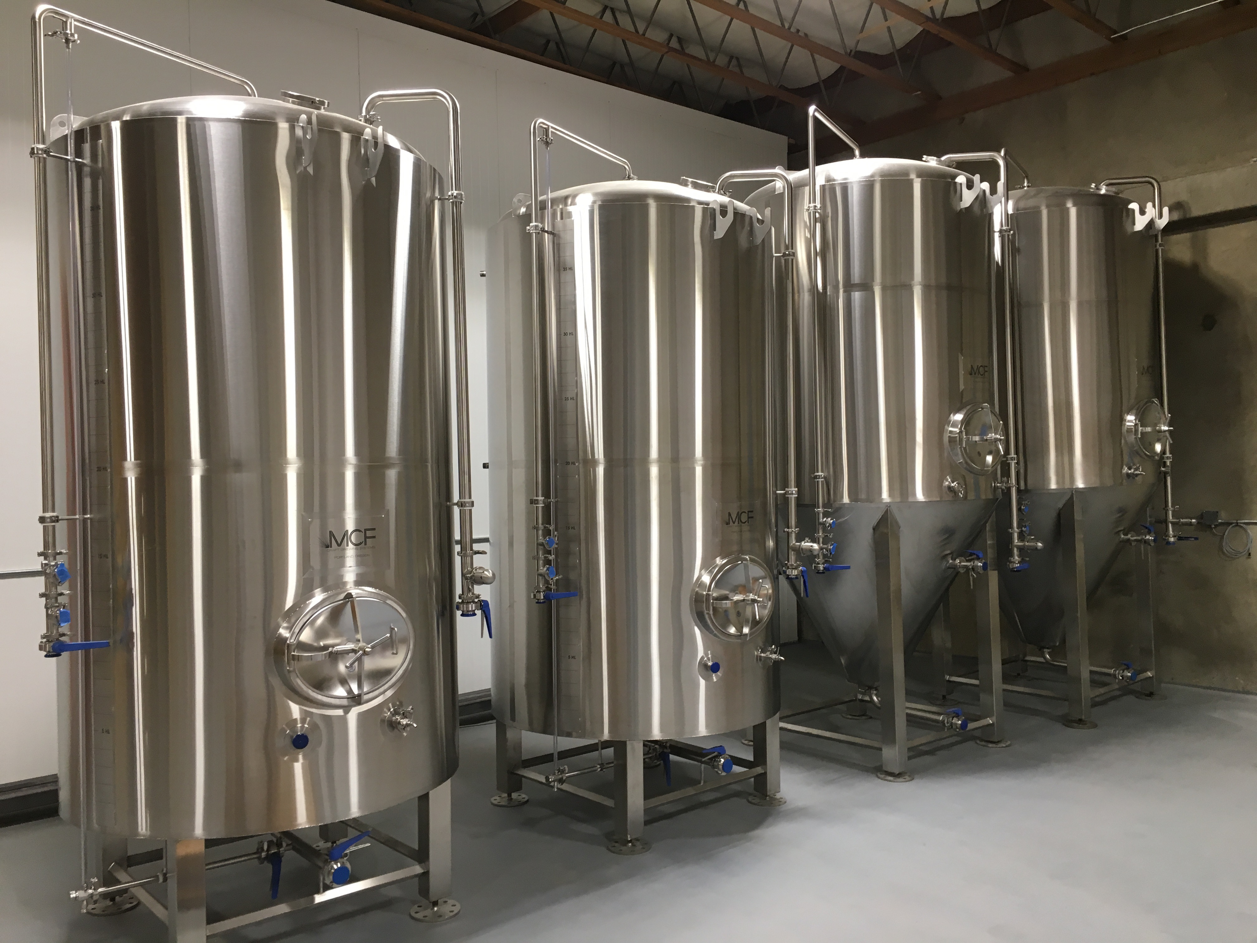 New fermentors from Metal Craft wait to hold cider at the new production facility at 807 NE Couch.