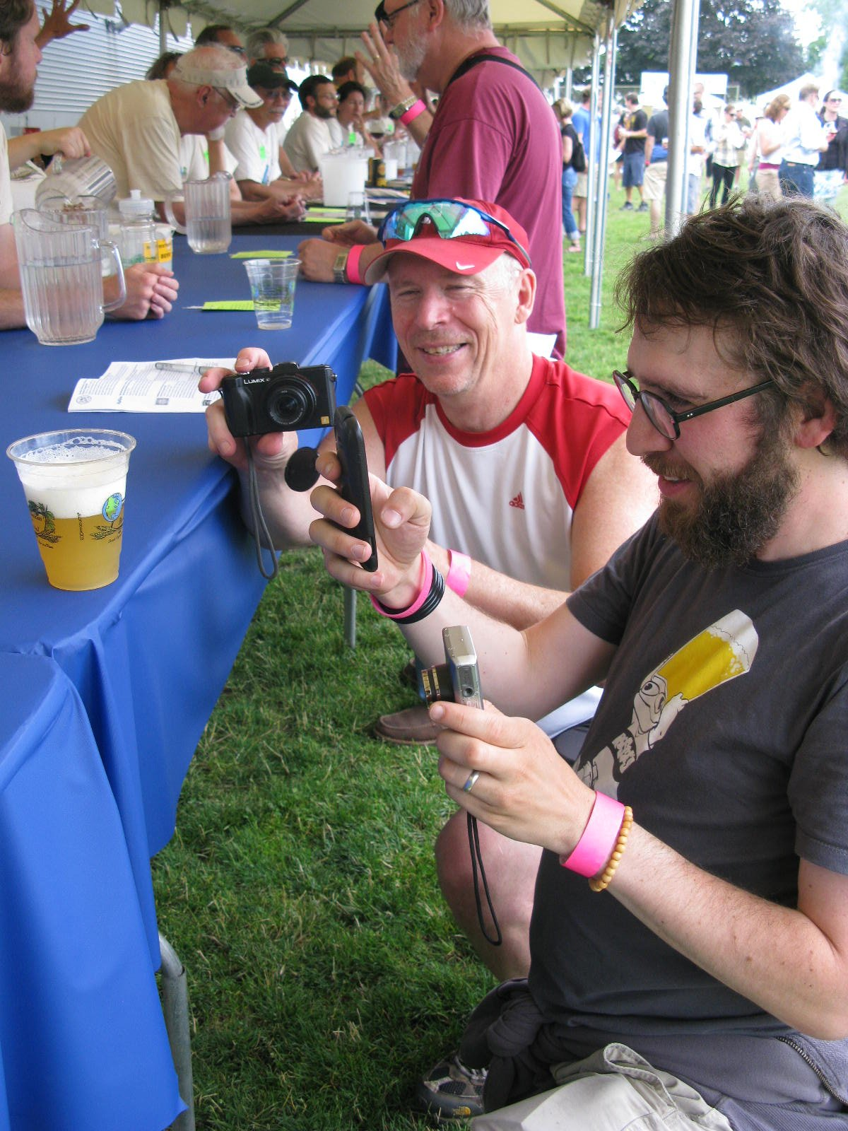 "Beer bloggers Pete Dunlop and Brewpublican Angelo deIeso take the all important first step in modern beer-drinking: photograph you beer and post to snapchat, instagram or whatever via satellite. Next they'll presumably observe the late Fred Eckhardt's injunction to ""listen to your beer"" and may eventually get around to actually drinking the beer...maybe. (FoystonFoto)"