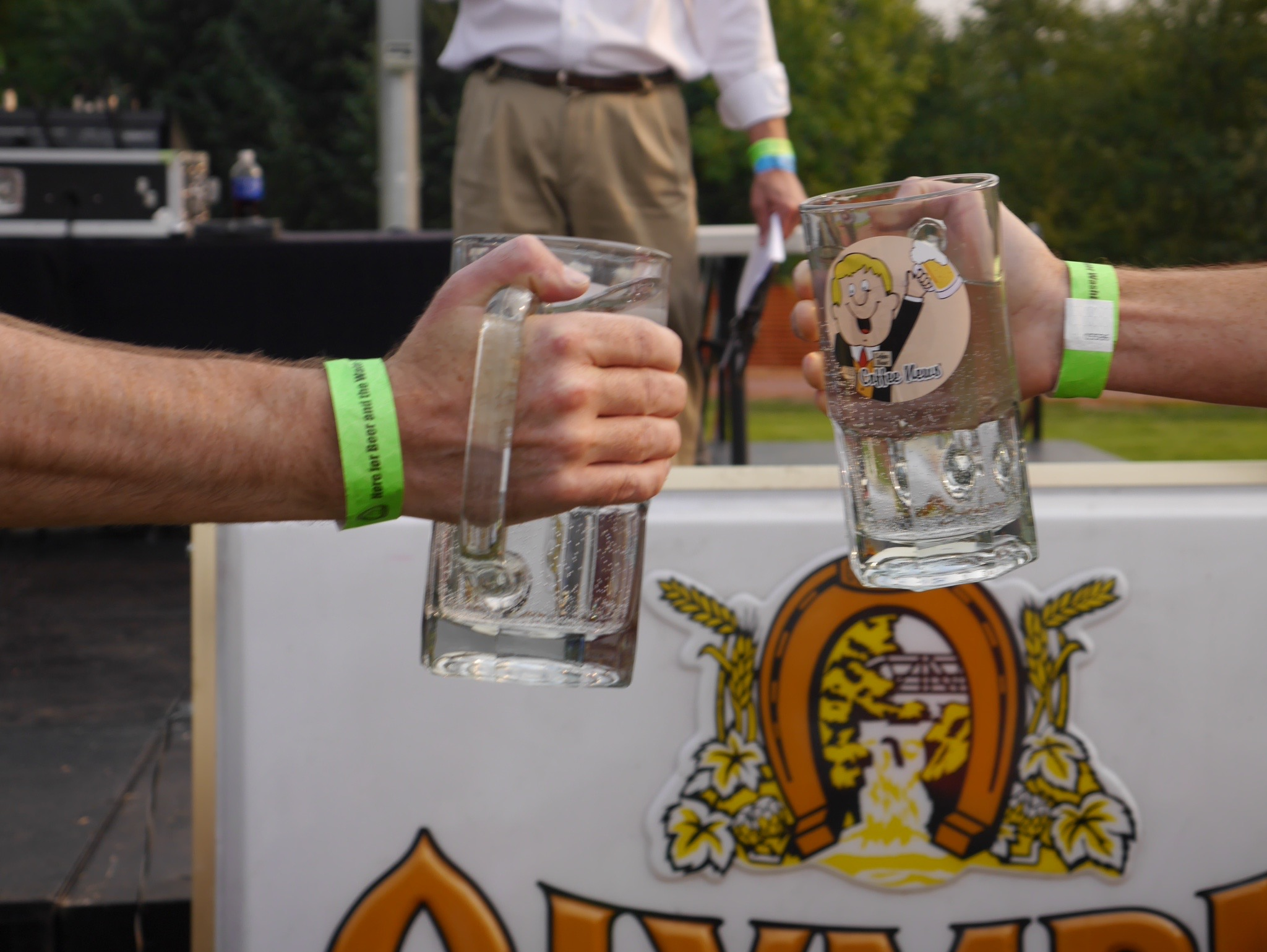 The mugs are getting heavy during the Stein Holiding Contest at the Tumwater Artesian Brewfest. (photo by Cat Stelzer)