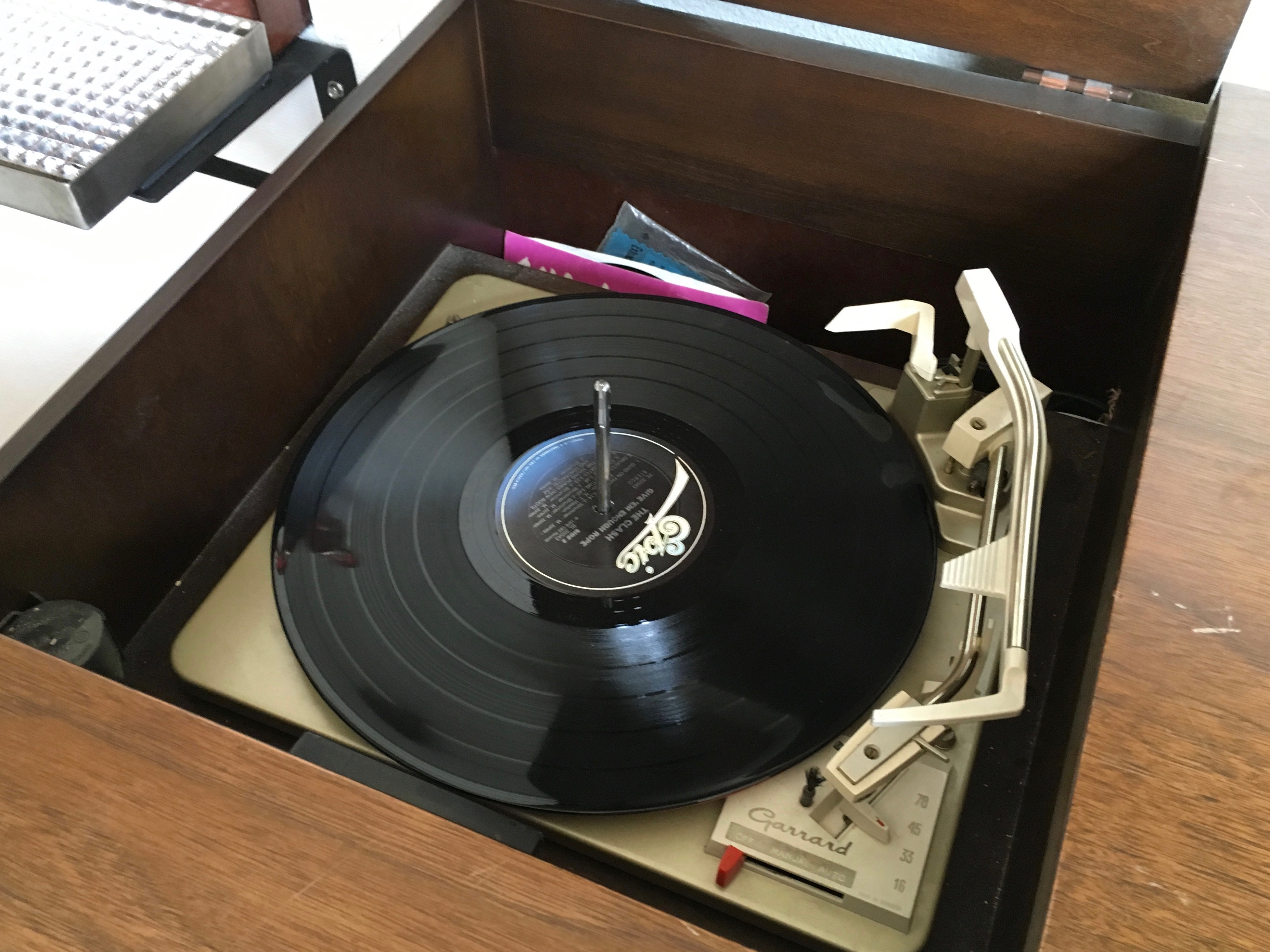 The old cabinet stereo system that features a turntable and even an 8-Track Player at Cider Riot! Pub.