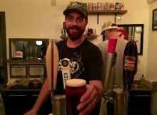 Brian Koch proudly pours a beer at Lombard House, his very own bar.
