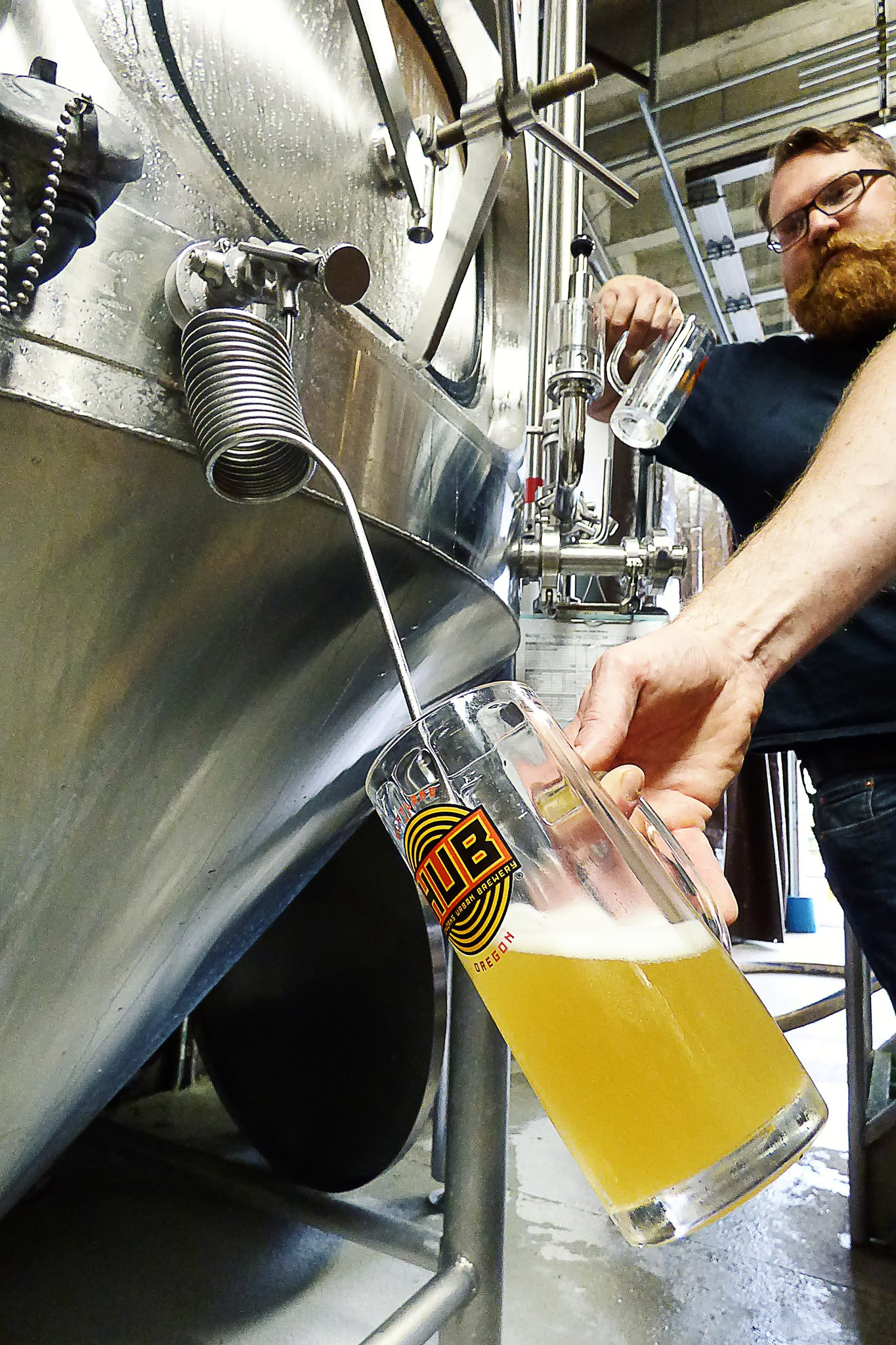 Pulling a sample of its North German Pilsner collaboration with Hopworks off the zwickel. (image courtesy of Wayfinder Beer)