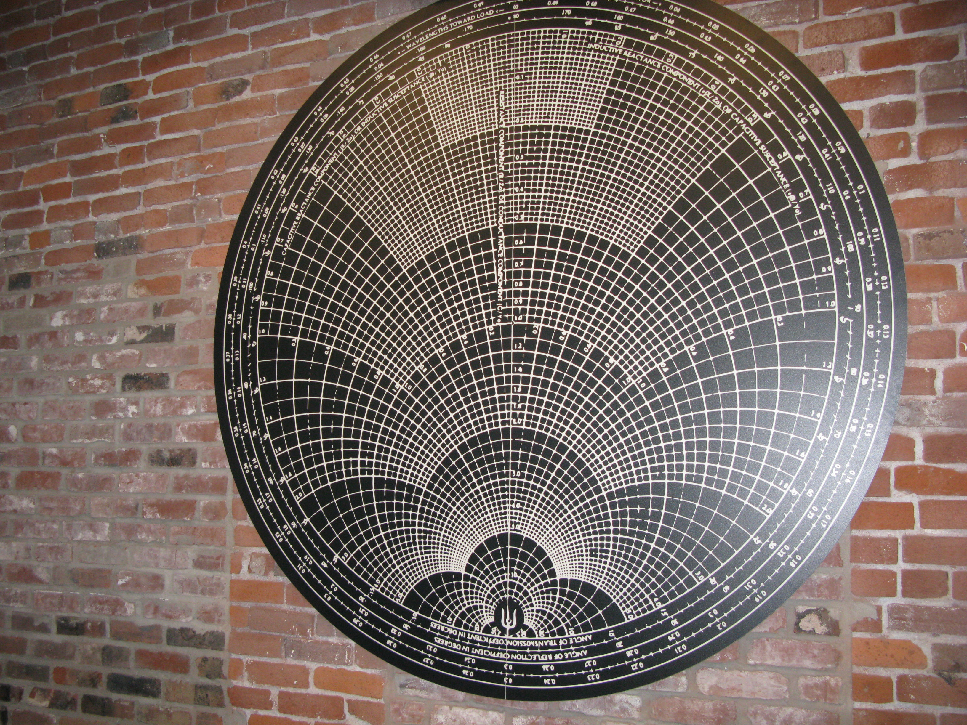 Portland graphic artist Orion Landau is the man behind the fine art on the brick walls, geometric meditations on sacred geometry. This, the biggest, is based, I believe, on the logarithmic grid of an oscilloscope screen...cool stuff indeed. (FoystonFoto)