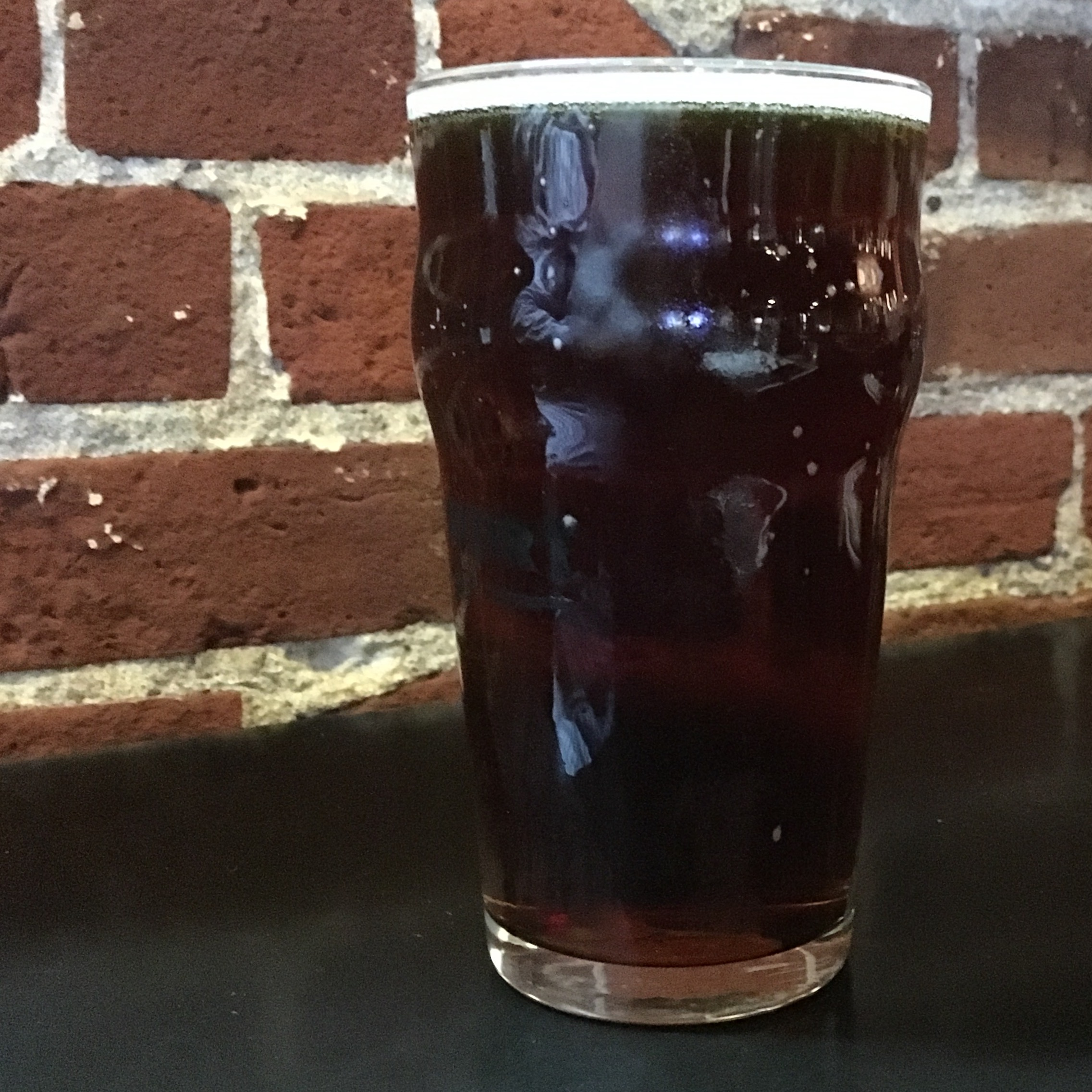 An Imperial Pint of BridgePort Brewing Stumptown Oatmeal Red Ale (ORA) at the pub in Portland, Oregon.