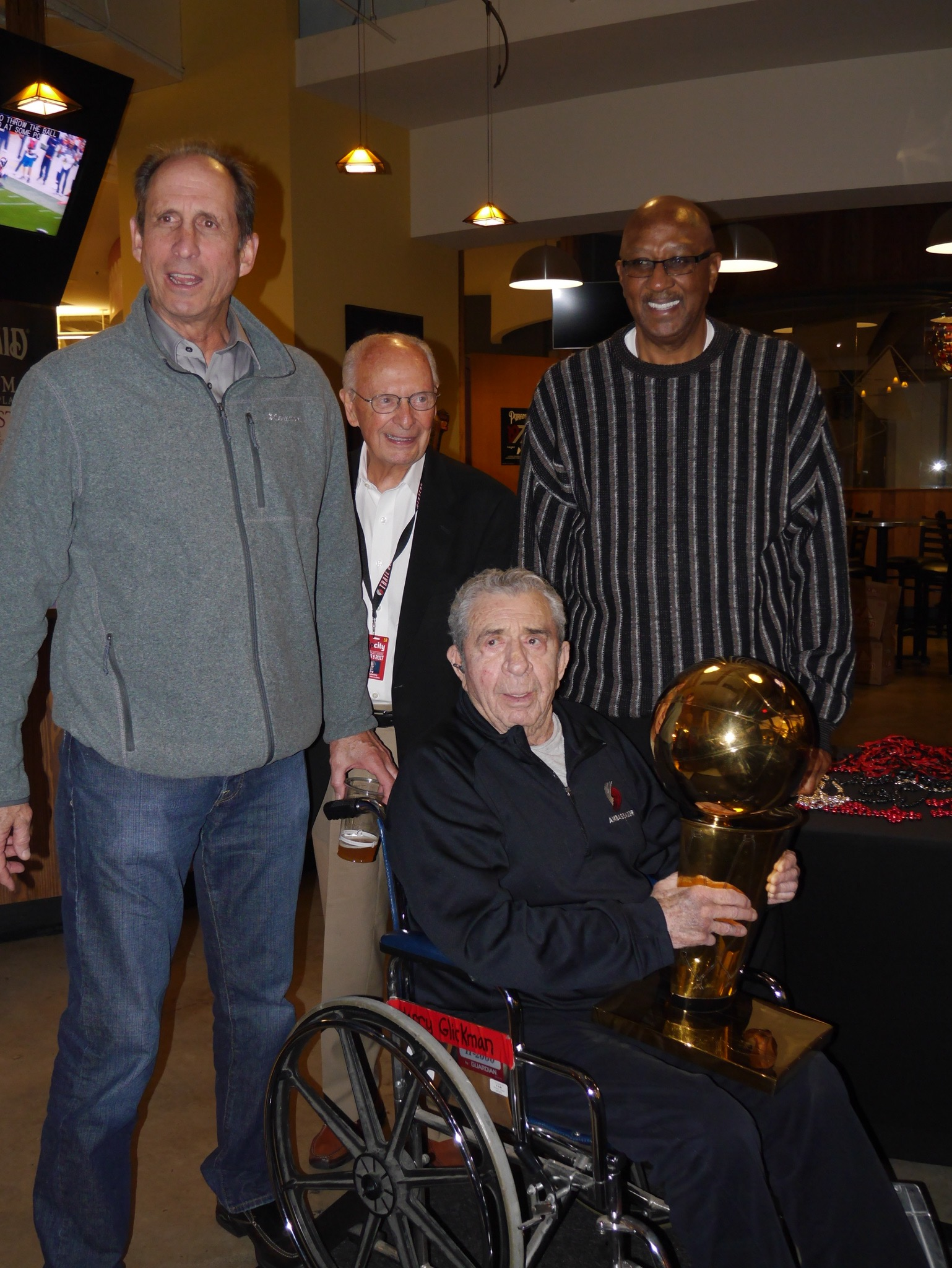 Bob Gross, Bill Schonely, Harry Glickman and Lloyd Neal proudly holding the 1977 Portland Trail Blazers NBA Championship trophy. (photo by Cat Stelzer)