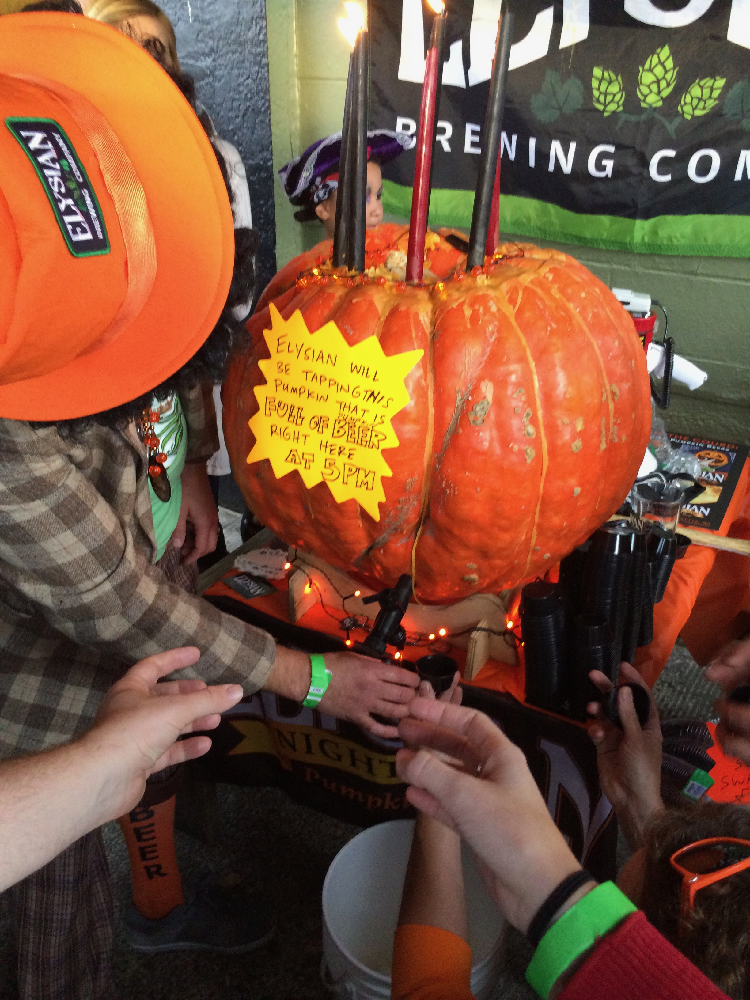 Elysian Brewing pouring its pumpkin beer from directly from a gourd that included canned peaches added to the beer.