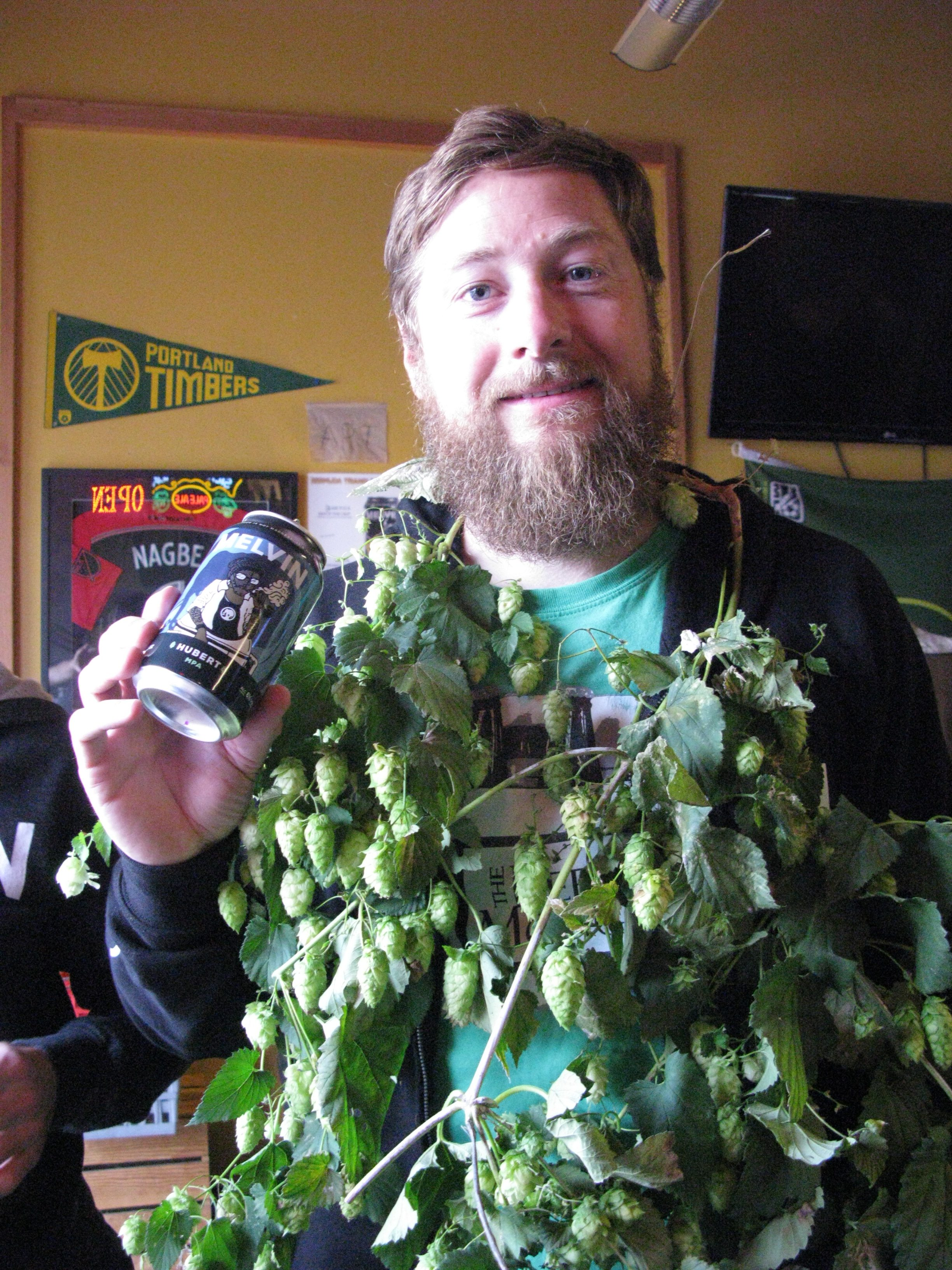 Jeremy Tofte with hops all over him at The BeerMongers. (FoystonFoto)