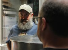 Longtime Rogue Brewmaster John Maier discussing his brew with the Green Dragon Brew Crew. (photo courtesy of Rogue Ales)