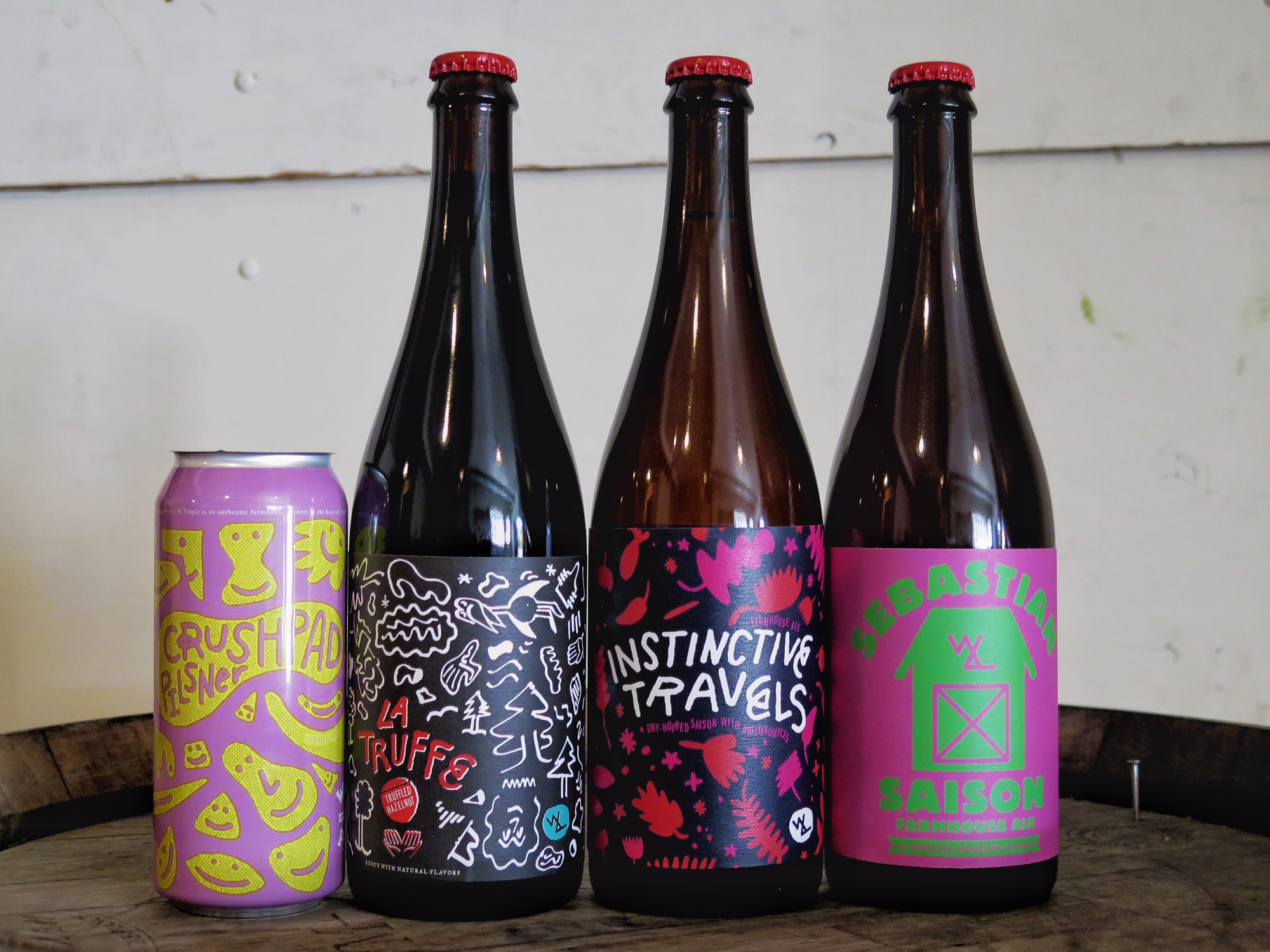 New releases from Wolves & People Farmhouse Brewery include Crush Pad Pilsner, La Truffe, Instinctive Travels, and Sebastian Saison. (photo courtesy of Wolves & People Farmhouse Brewery)