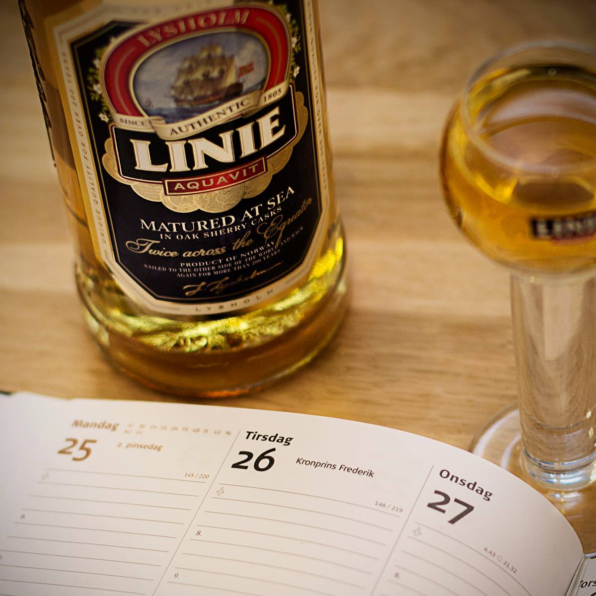 A bottle of Linie Aquavit that is matured at sea. (image courtesy of Linie Aquavit)