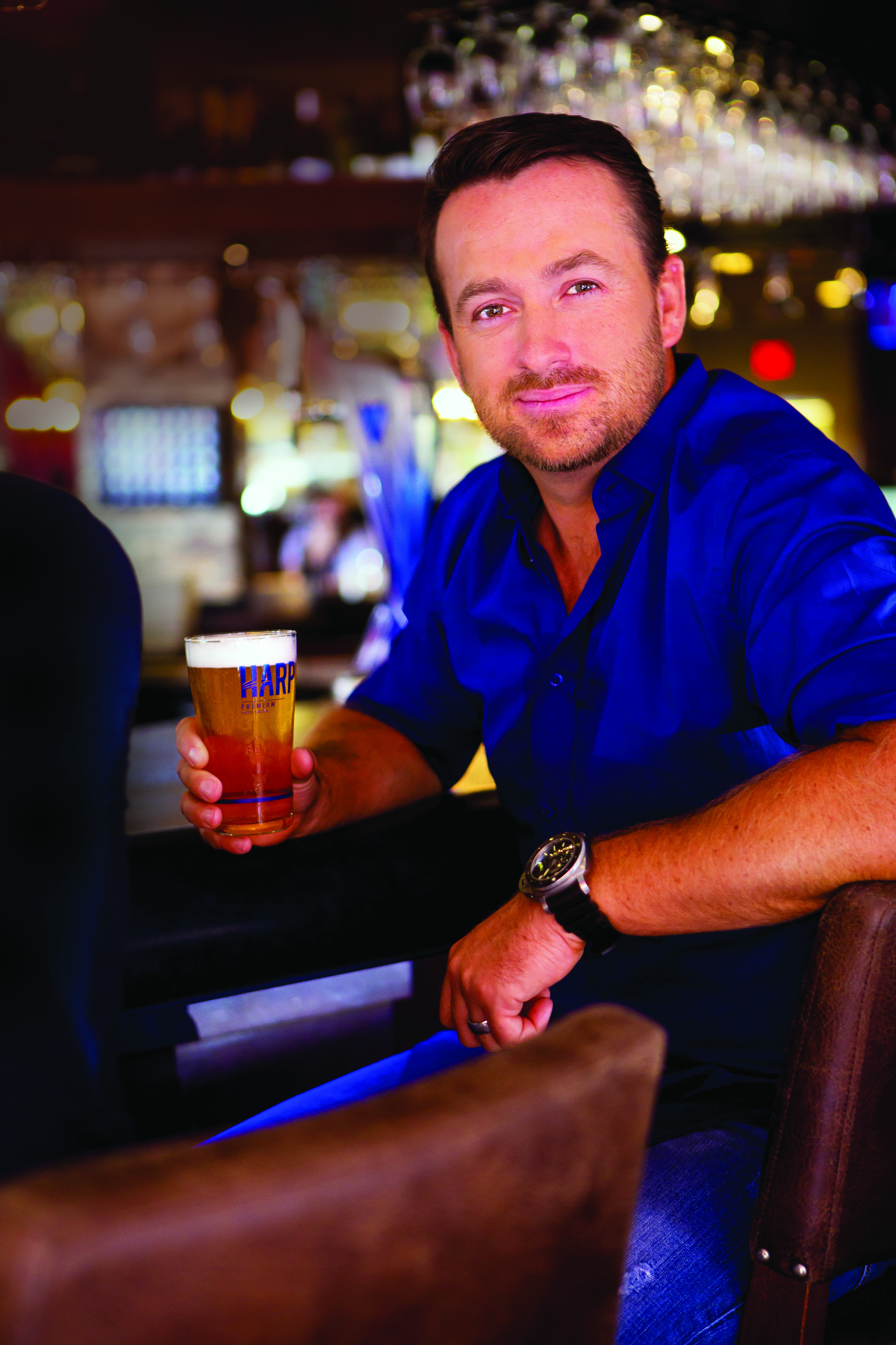 Graeme McDowell with a pint of Harp Lager. (image courtesy of Harp Lager)