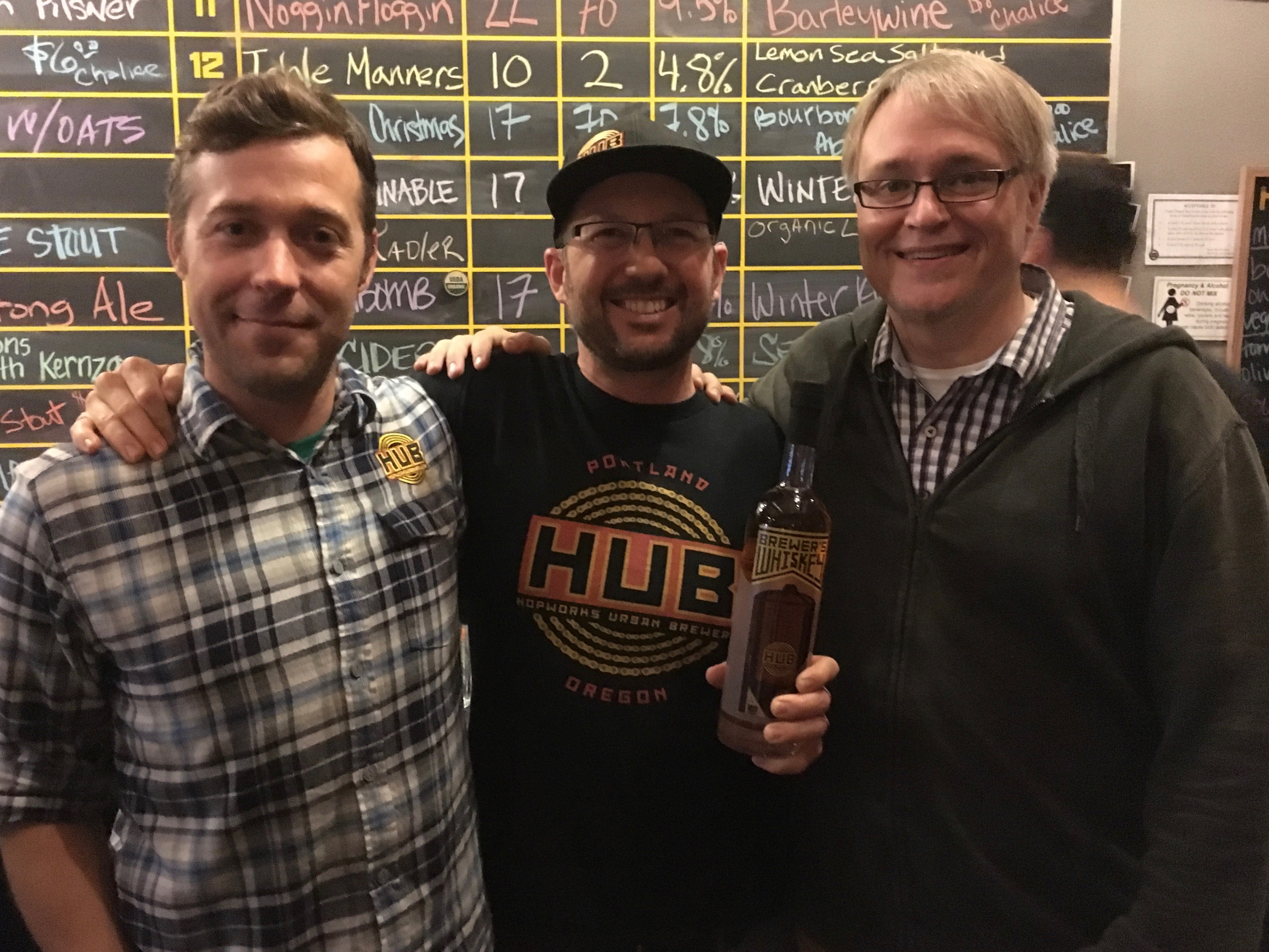 Hopworks Urban Brewery's Trever Bass and Christian Ettinger with Tom Burkleaux, owner of New Deal Distillery.