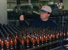 Kurt Widmer and one of Widmer's first runs of bottles. (image courtesy of Widmer Brothers Brewing)