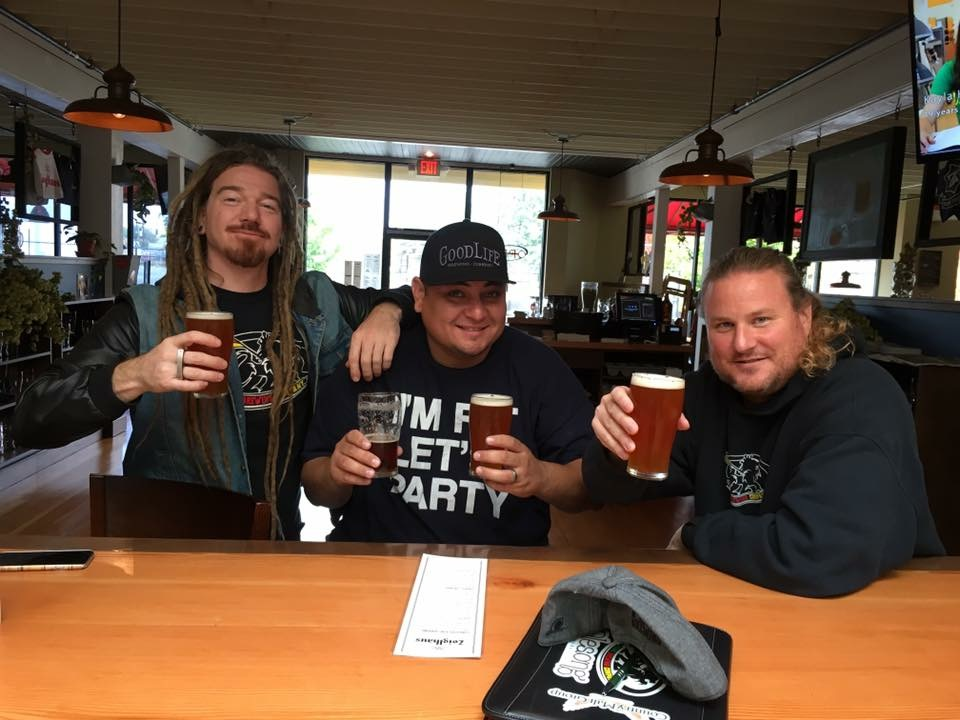 Pono Brewing's Erick Russ, left, Josh Huerta and Larry Clouser raise a pint of their limited release Tropical Thunder IPA. (FoystonFoto)