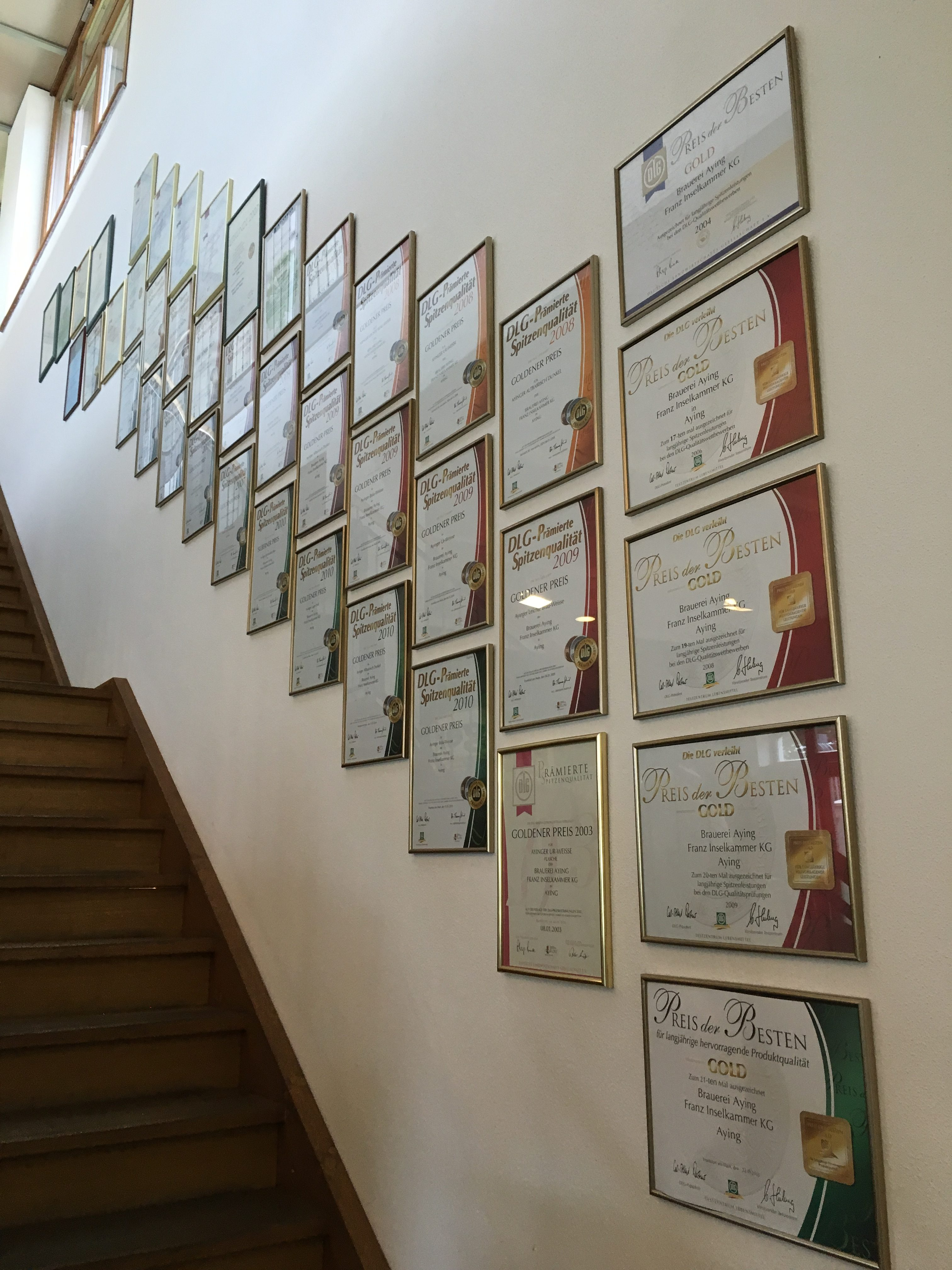 A stairway of Ayinger brewing awards.