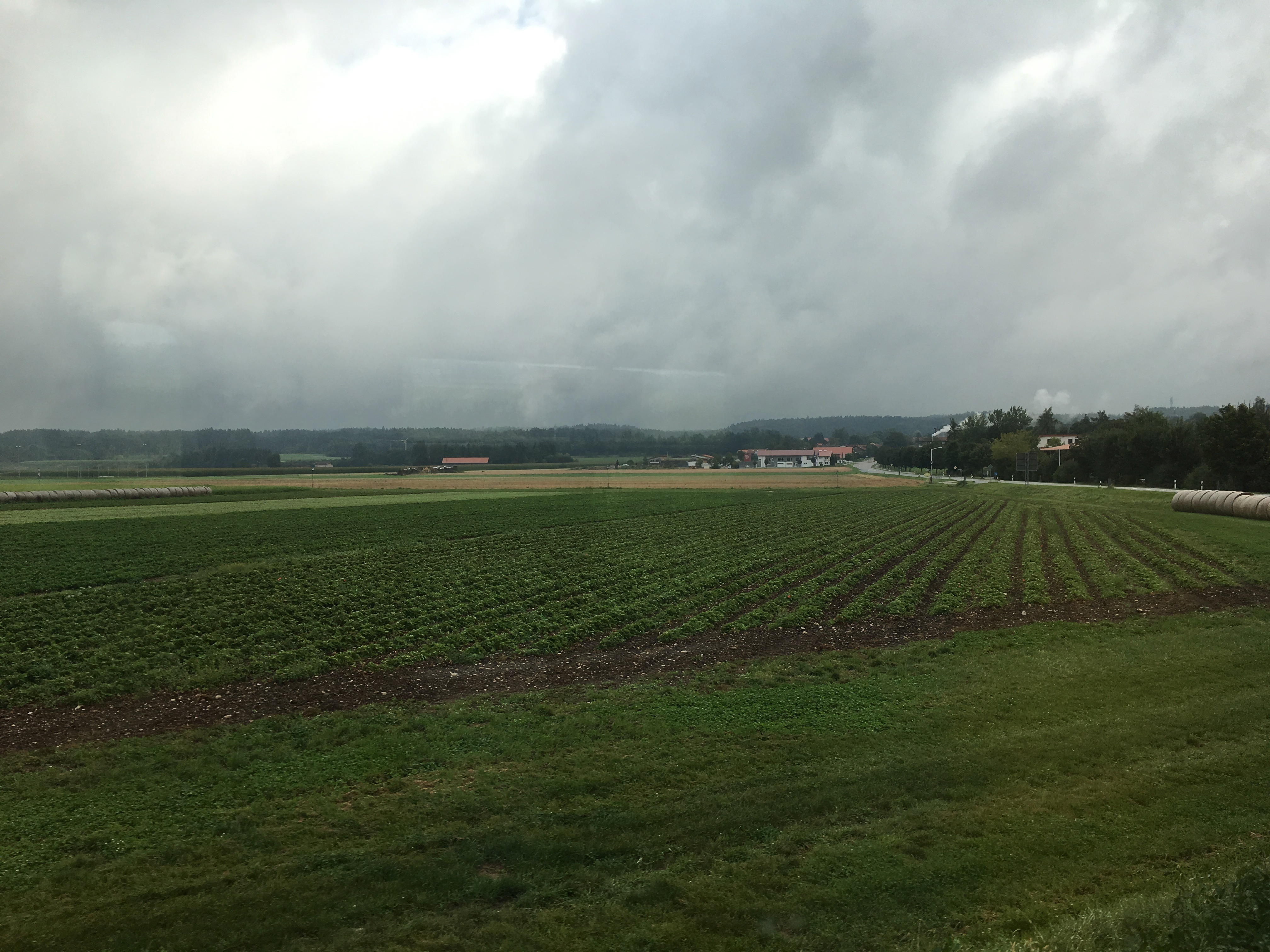 Ayinger Brewery in the distance from the train arriving into Aying, Germany.