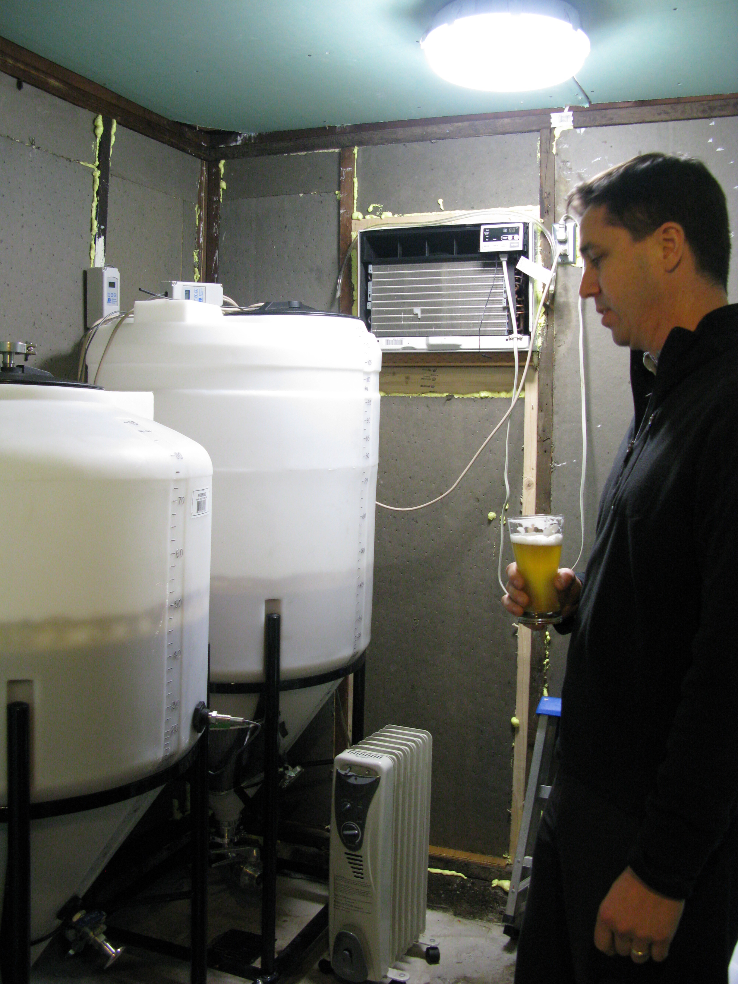 Mike Wright and his early fermenters at Beetje Brewing, now known as The Commons Brewery. (FoystonFoto)